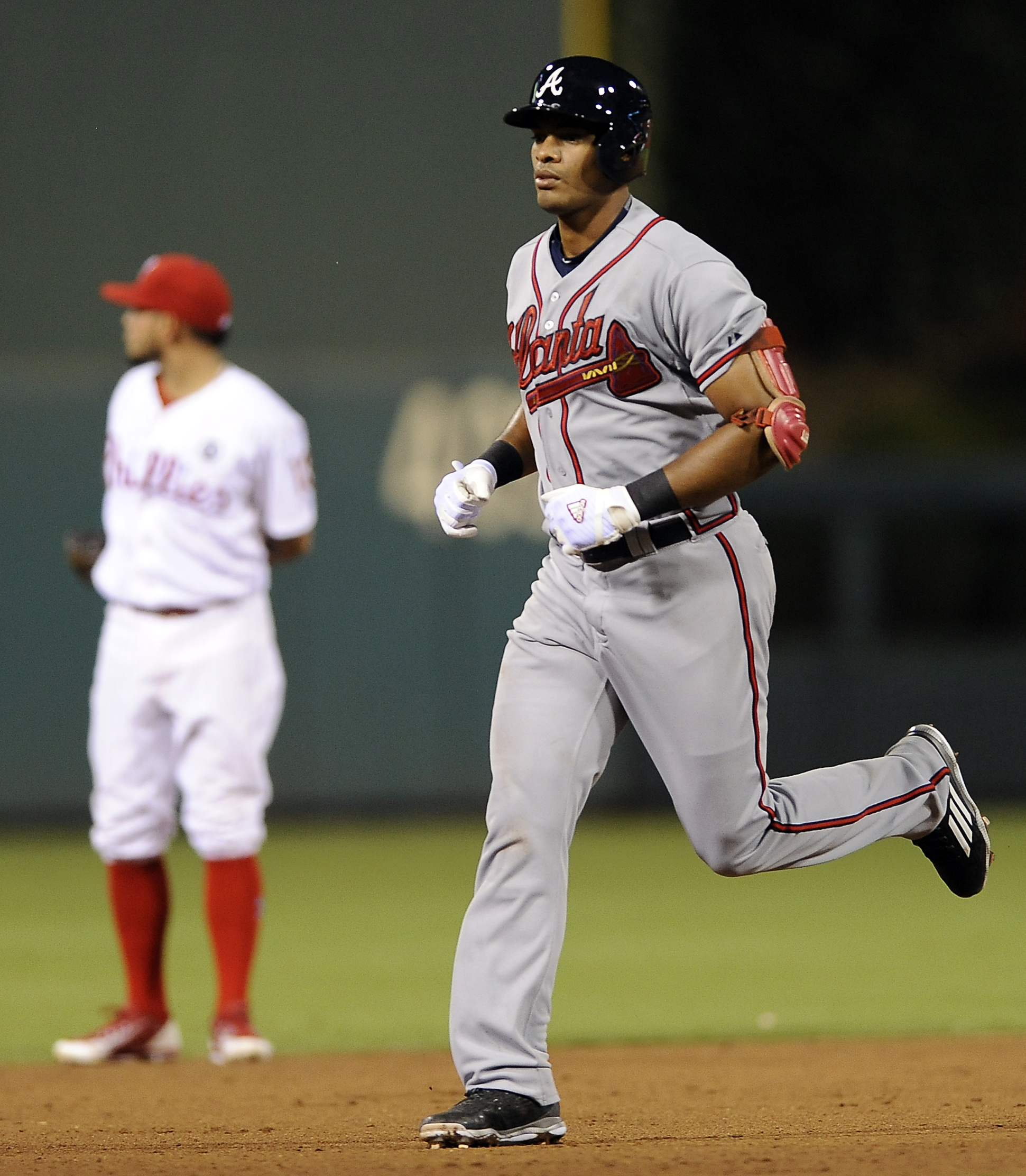 Atlanta Braves' Hector Olivera rounds the bases after hitting a two-run homer in the ninth inning of a baseball game against the Philadelphia Phillies, Monday, Sept. 7, 2015, in Philadelphia. The Braves won 7-2. (AP Photo/Michael Perez)