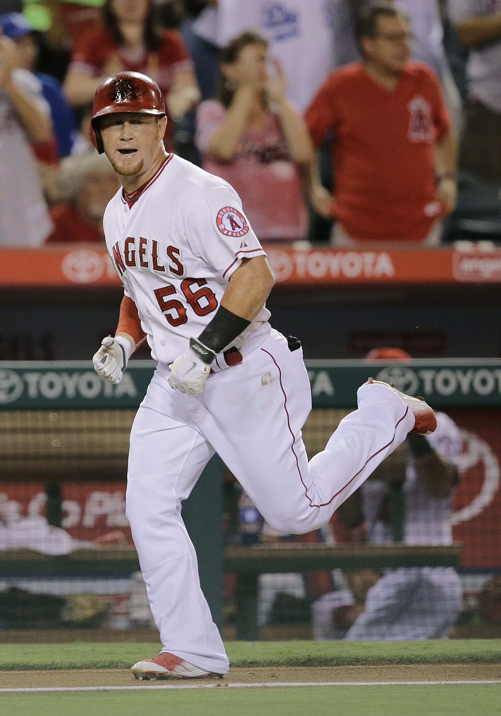 Los Angeles Angels' Kole Calhoun celebrates his two-run home run during the fifth inning of a baseball game against the Los Angeles Dodgers, Monday, Sept. 7, 2015, in Anaheim, Calif. (AP Photo/Jae C. Hong)