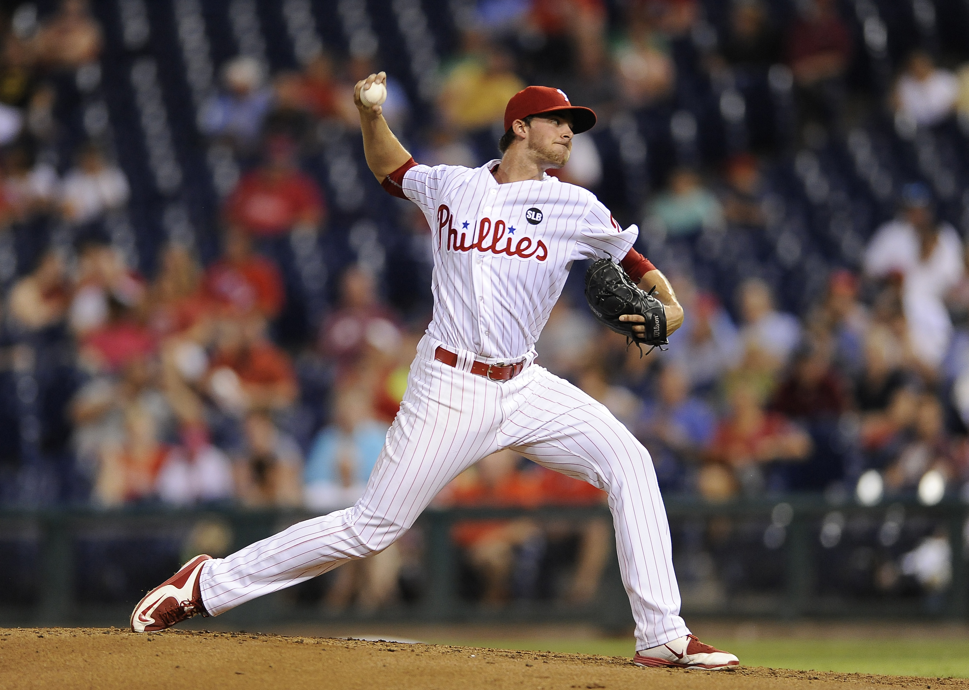 Philadelphia Phillies starting pitcher Aaron Nola throws in the third inning of a baseball game against the Atlanta Braves, Tuesday, Sept. 8, 2015, in Philadelphia. (AP Photo/Michael Perez)