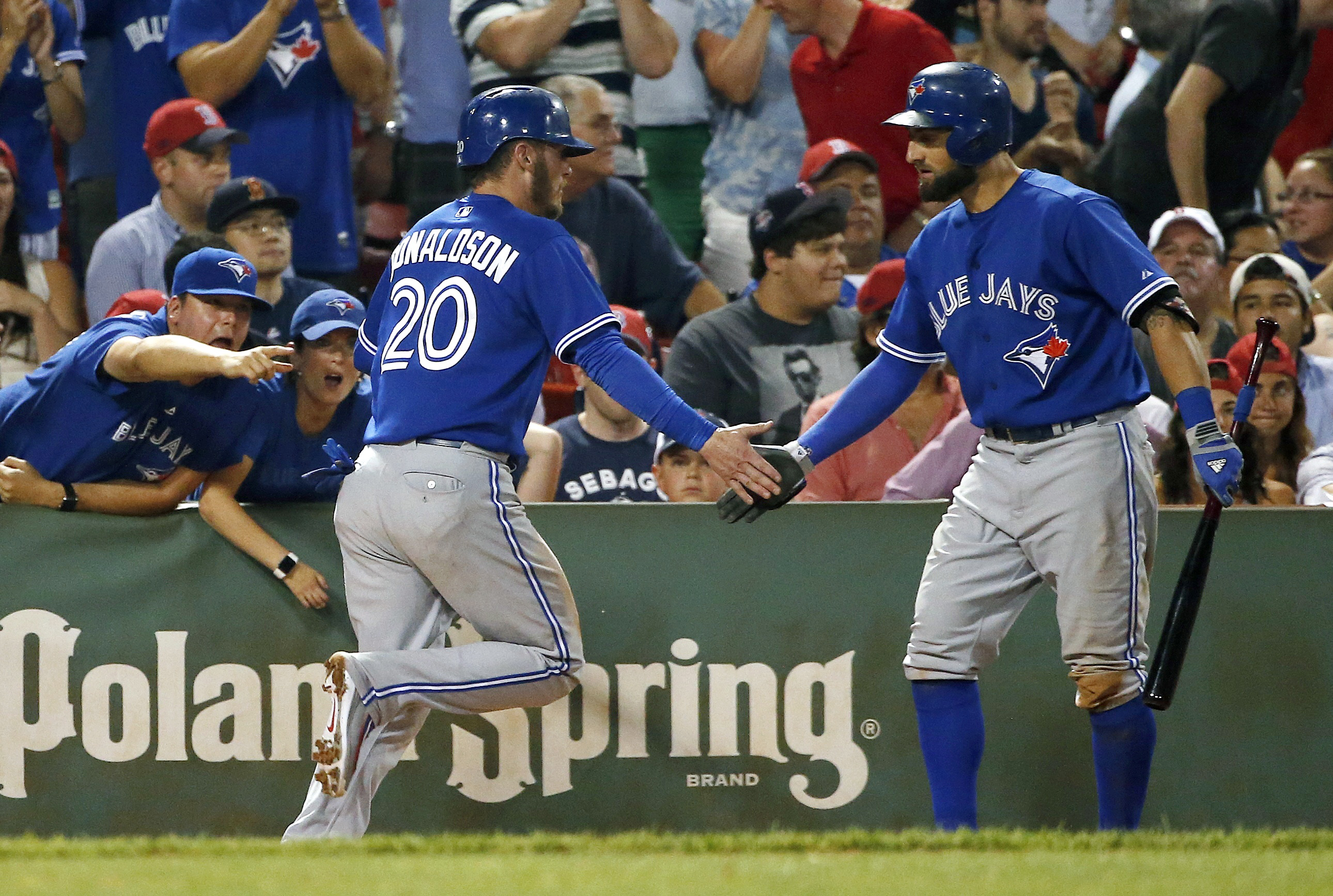 Toronto Blue Jays' Josh Donaldson (20) celebrates after scoring the go-ahead run on a single by Troy Tulowitzki during the 10th inning of a baseball game against the Boston Red Sox in Boston, Tuesday, Sept. 8, 2015. (AP Photo/Michael Dwyer)