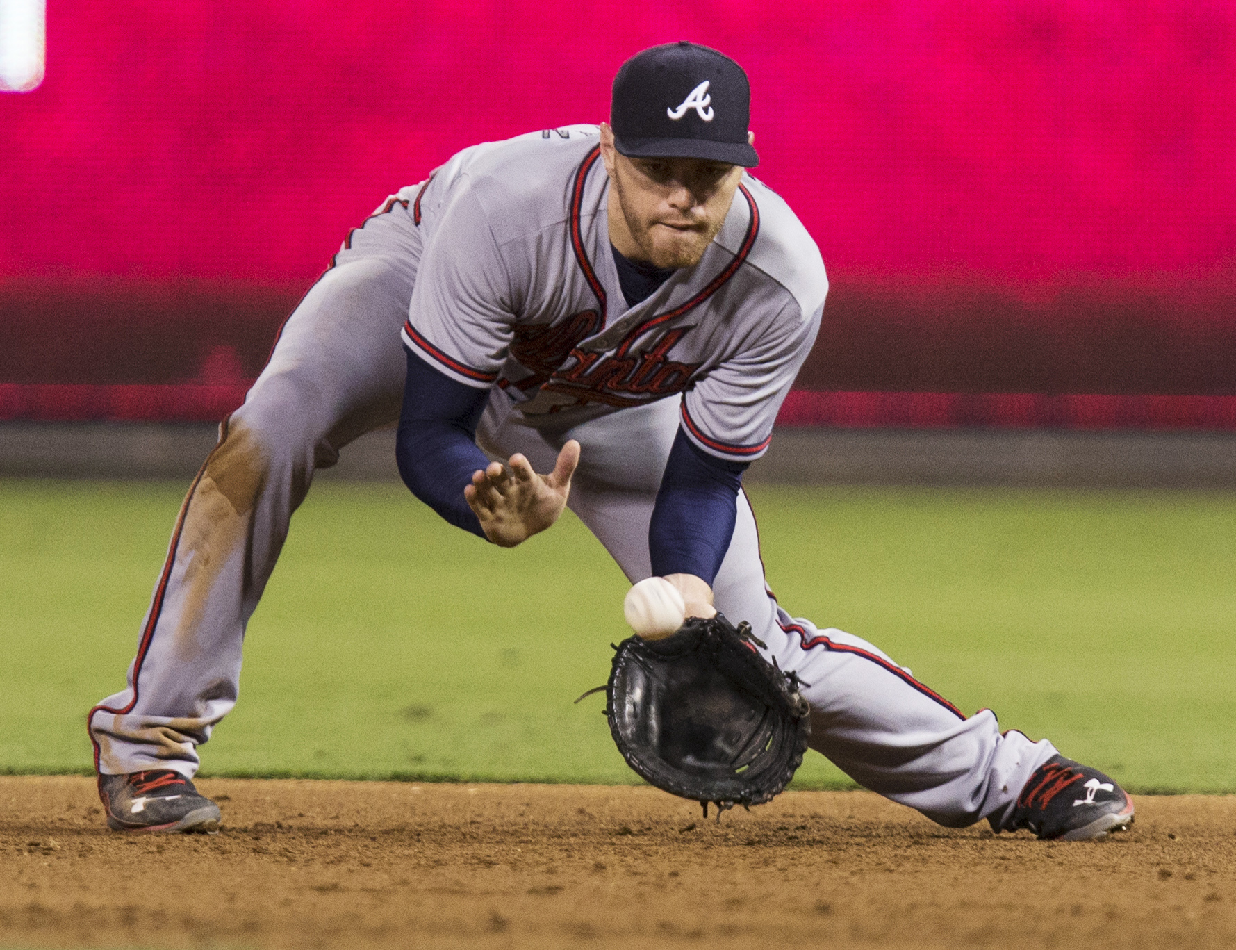 Atlanta Braves first baseman Freddie Freeman fields a grounder by Philadelphia Phillies' Ryan Howard during the fourth inning of a baseball game, Wednesday, Sept. 9, 2015, in Philadelphia. Howard was out at first. (AP Photo/Laurence Kesterson)
