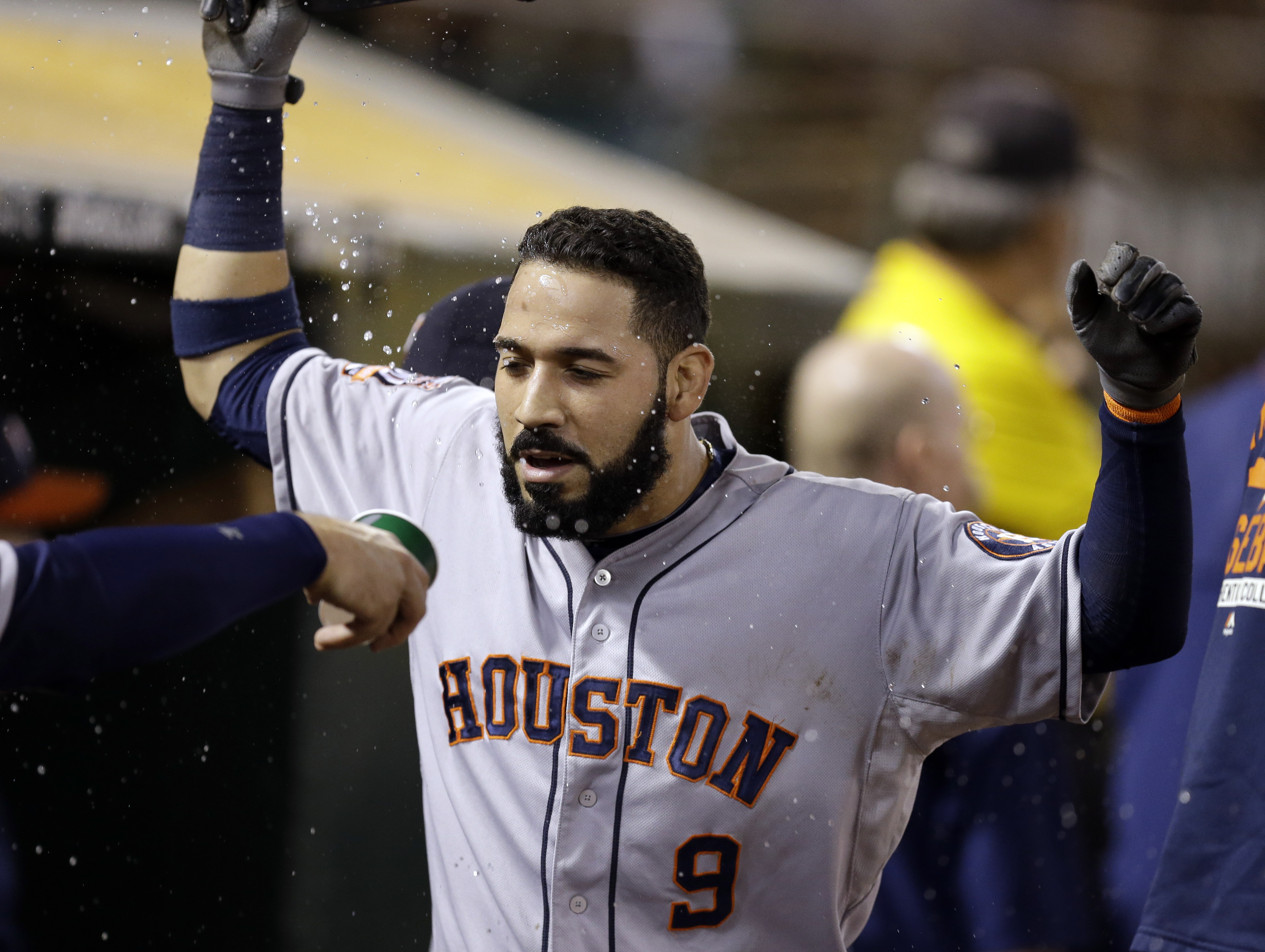 Houston Astros' Marwin Gonzalez (9) has water thrown in his face by a teammate after hitting a home run against the Oakland Athletics during the seventh inning of a baseball game Wednesday, Sept. 9, 2015, in Oakland, Calif. (AP Photo/Ben Margot)