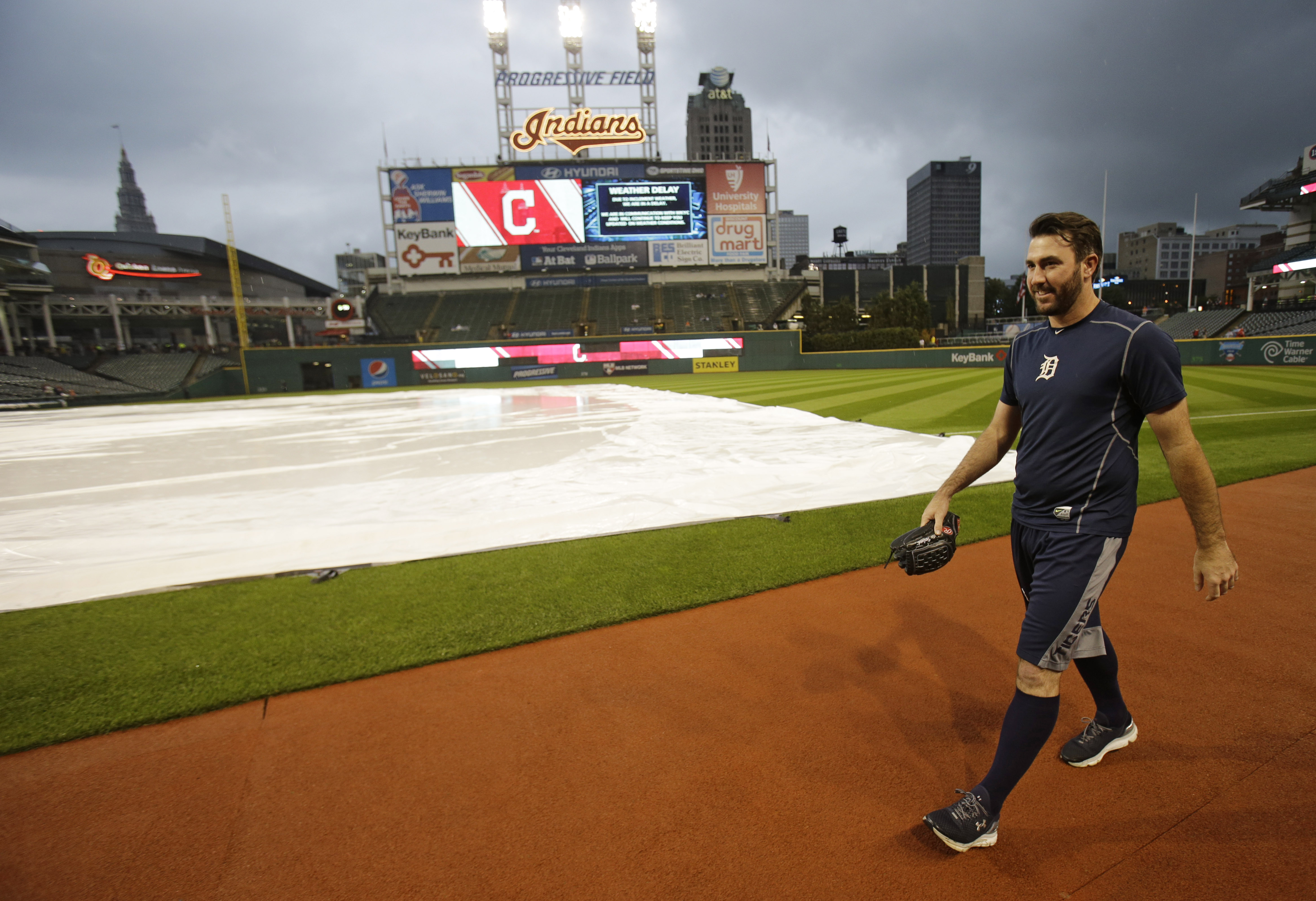 Detroit Tigers starting pitcher Justin Verlander walks off the field after warming up before a baseball game against the Cleveland Indians, Friday, Sept. 11, 2015, in Cleveland. The game was postponed due to the weather. (AP Photo/Tony Dejak)