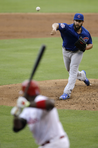Chicago Cubs' Jake Arrieta, right, pitches to Philadelphia Phillies' Ryan Howard during the second inning of the first game of a baseball doubleheader, Friday, Sept. 11, 2015, in Philadelphia. Chicago won 5-1. (AP Photo/Matt Slocum)