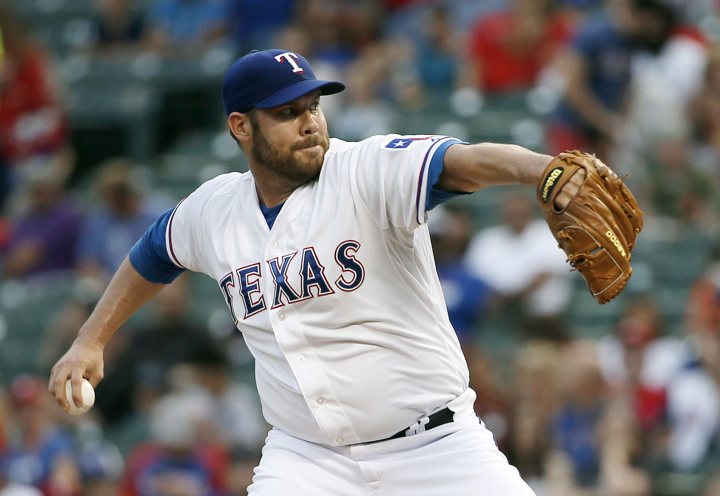 Texas Rangers starting pitcher Colby Lewis works against the Oakland Athletics during the first inning of a baseball game Friday, Sept. 11, 2015, in Arlington, Texas. (AP Photo/Tony Gutierrez)