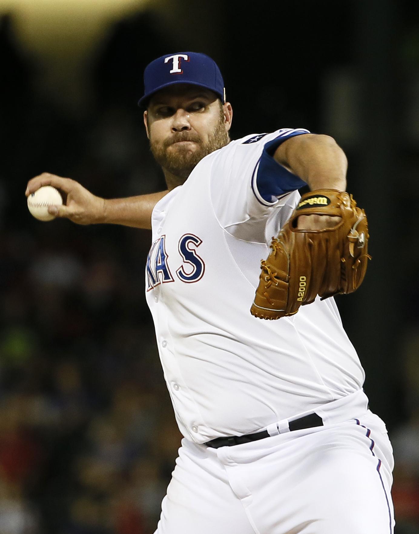 Texas Rangers starting pitcher Colby Lewis works against the Oakland Athletics during the seventh inning of a baseball game Friday, Sept. 11, 2015, in Arlington, Texas. (AP Photo/Tony Gutierrez)