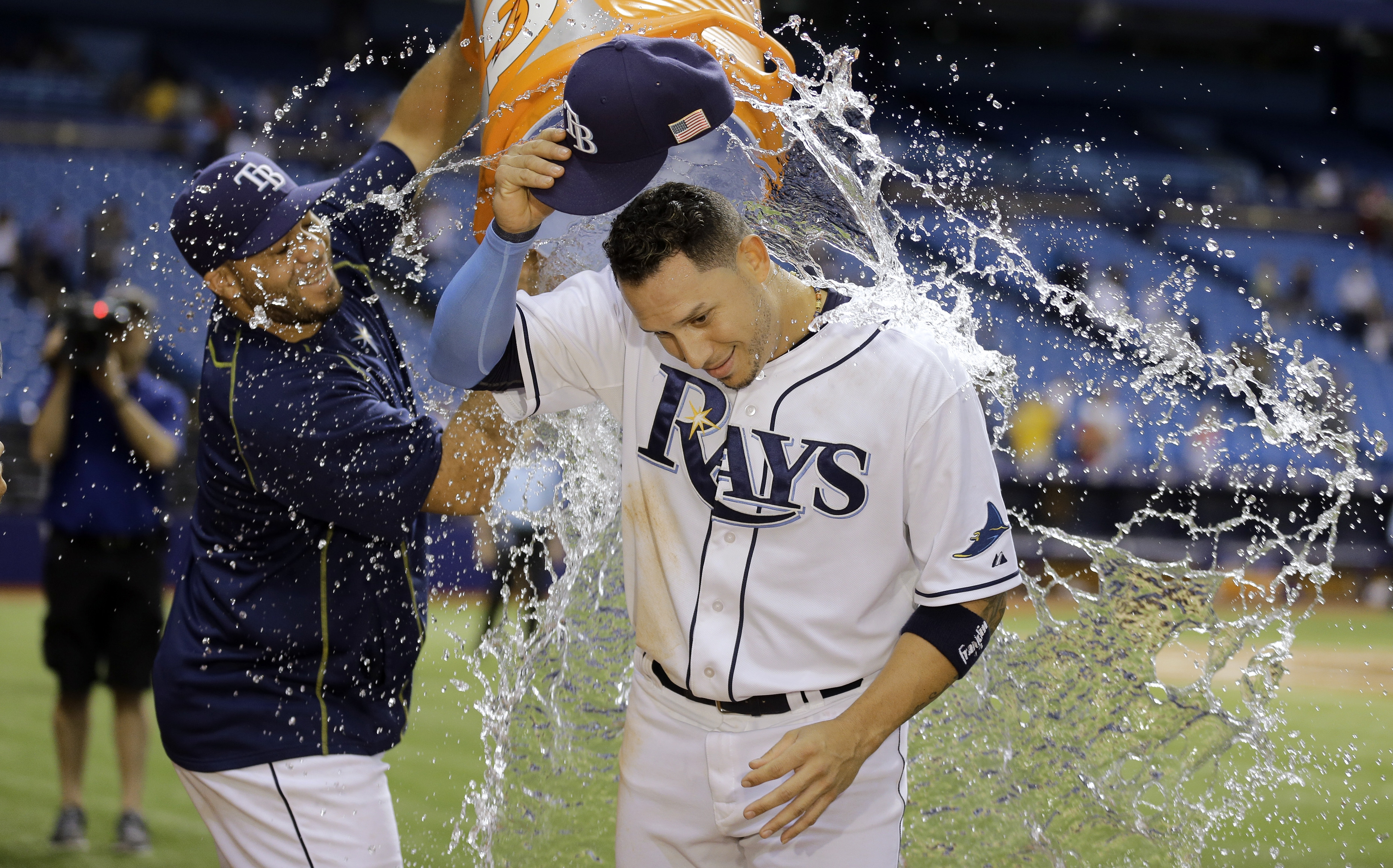 Tampa Bay Rays' Asdrubal Cabrera, right, get doused with water by Rene Rivera after the Rays defeated the Boston Red Sox 8-4 in a baseball game Friday, Sept. 11, 2015, in St. Petersburg, Fla.  Cabrera had a two-run home run in the win. (AP Photo/Chris O'M