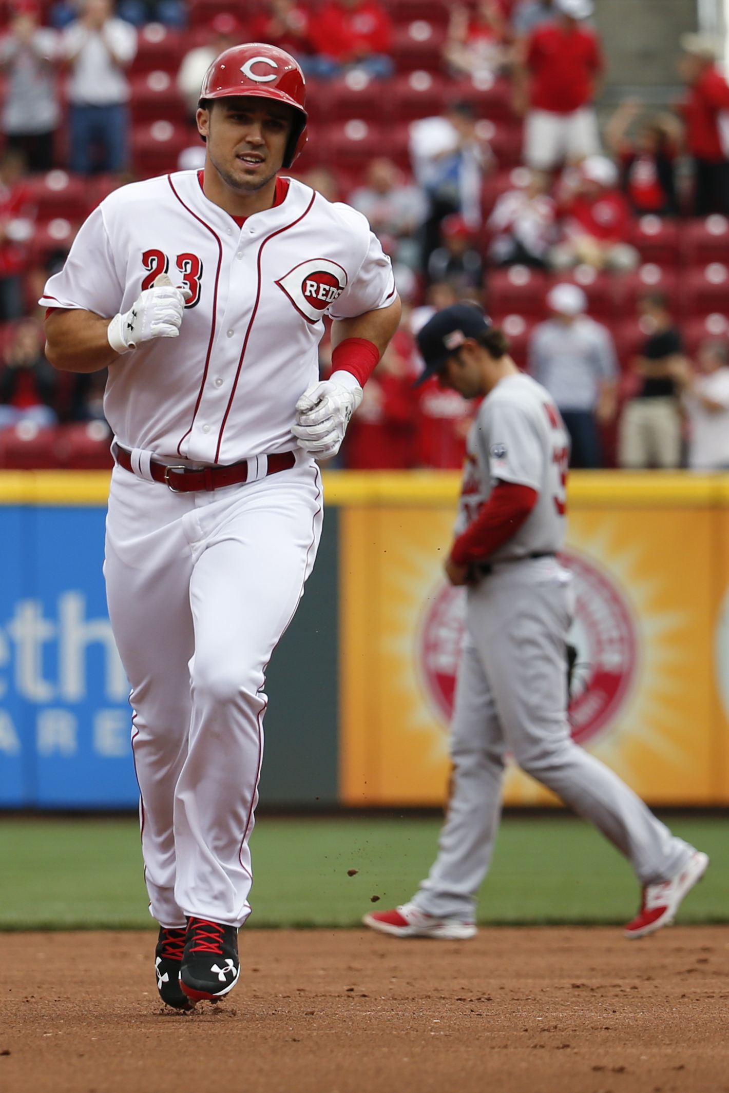 Cincinnati Reds' Adam Duvall rounds the bases after hitting a two-run home run off St. Louis Cardinals relief pitcher Jonathan Broxton in the eighth inning of a resumed baseball game, Saturday, Sept. 12, 2015, in Cincinnati. The game was resumed in the to