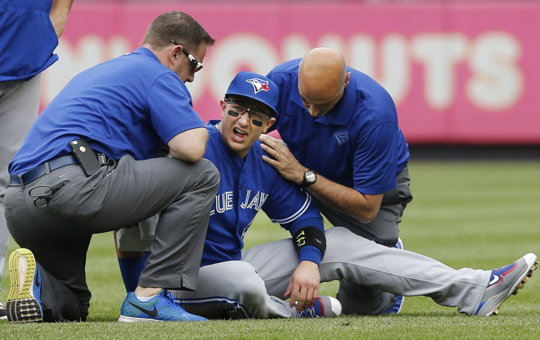 Toronto Blue Jays staff tend to Toronto Blue Jays shortstop Troy Tulowitzki, center, after he collided with Blue Jays center fielder Kevin Pillar fielding a fly ball in the second inning of a baseball game at Yankee Stadium in New York, Saturday, Sept. 12