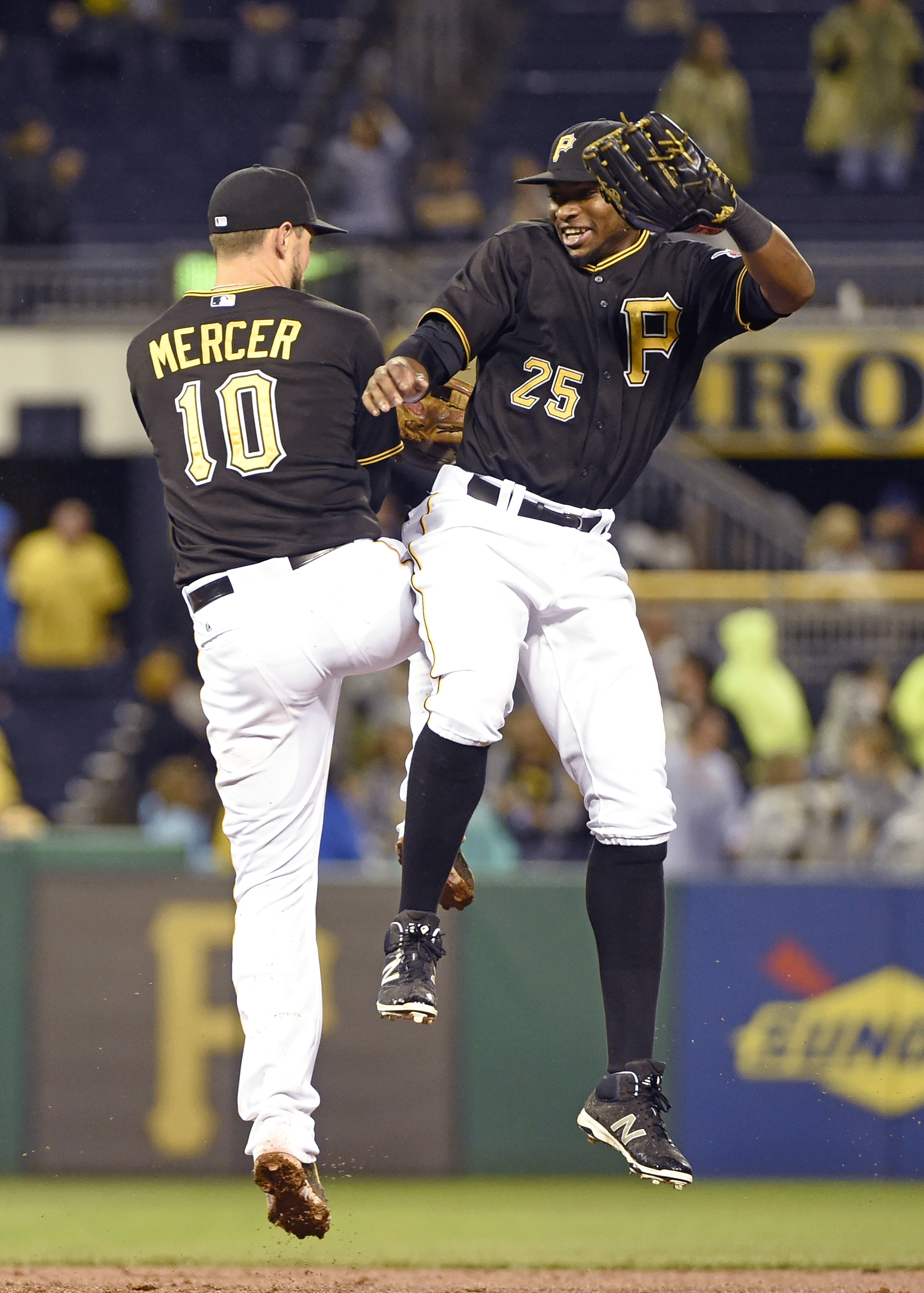 Pittsburgh Pirates' Jordy Mercer (10) and Gregory Polanco (25) celebrate their 10-2 victory over the Milwaukee Brewers, Saturday, Sept. 12, 2015, in Pittsburgh. (AP Photo/Fred Vuich)