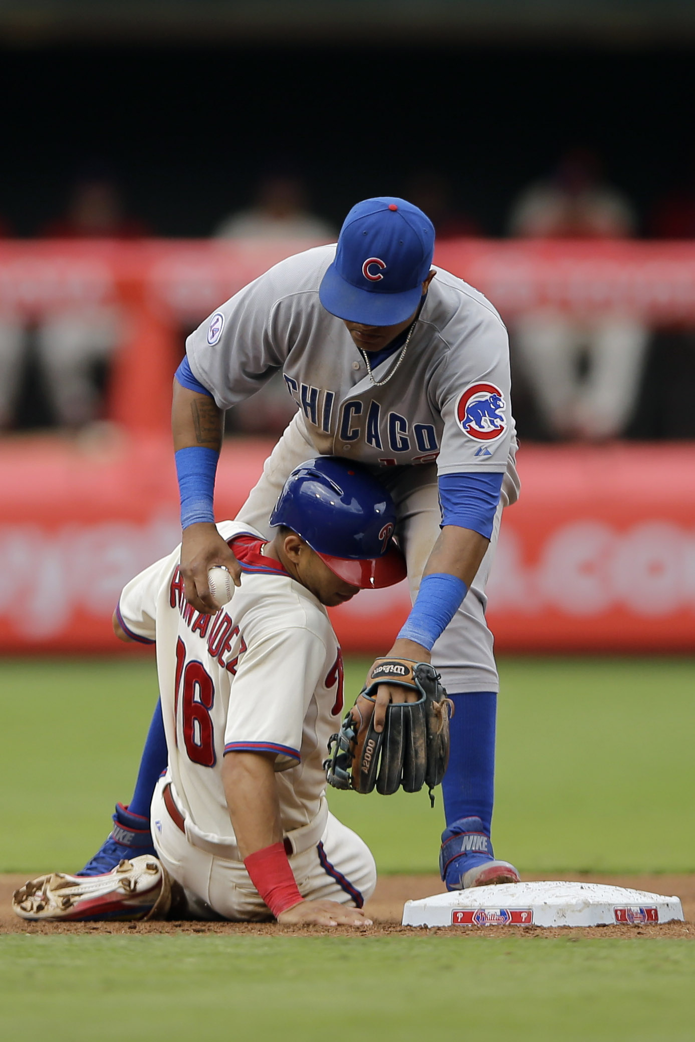Philadelphia Phillies' Cesar Hernandez, bottom, collides with Chicago Cubs shortstop Starlin Castro after being forced out at second base on a fielder's choice by Freddy Galvis during the fourth inning of a baseball game, Sunday, Sept. 13, 2015, in Philad