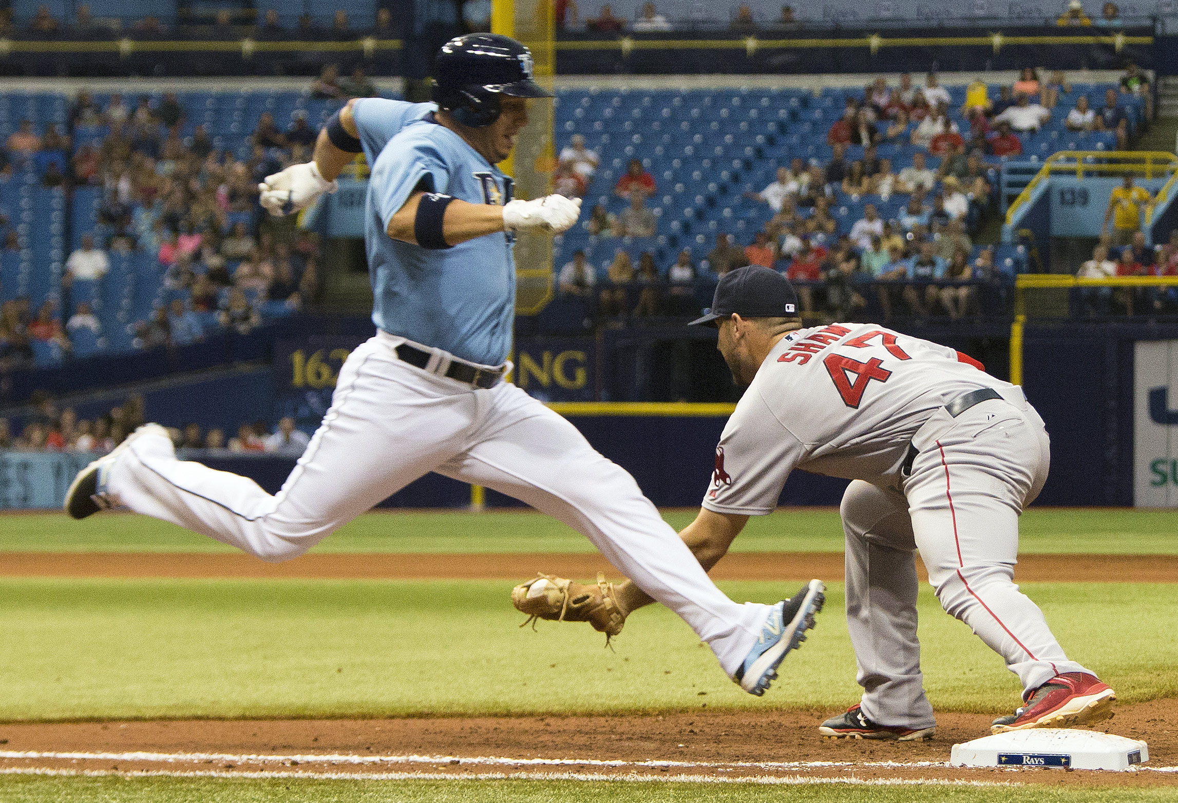 Boston Red Sox first baseman Travis Shaw (47) makes a force-out against Tampa Bay Rays shortstop Asdrubal Cabrera, left, during the ninth inning of a baseball game Sunday, Sept. 13, 2015, in St. Petersburg, Fla. (AP Photo/Luke Johnson)