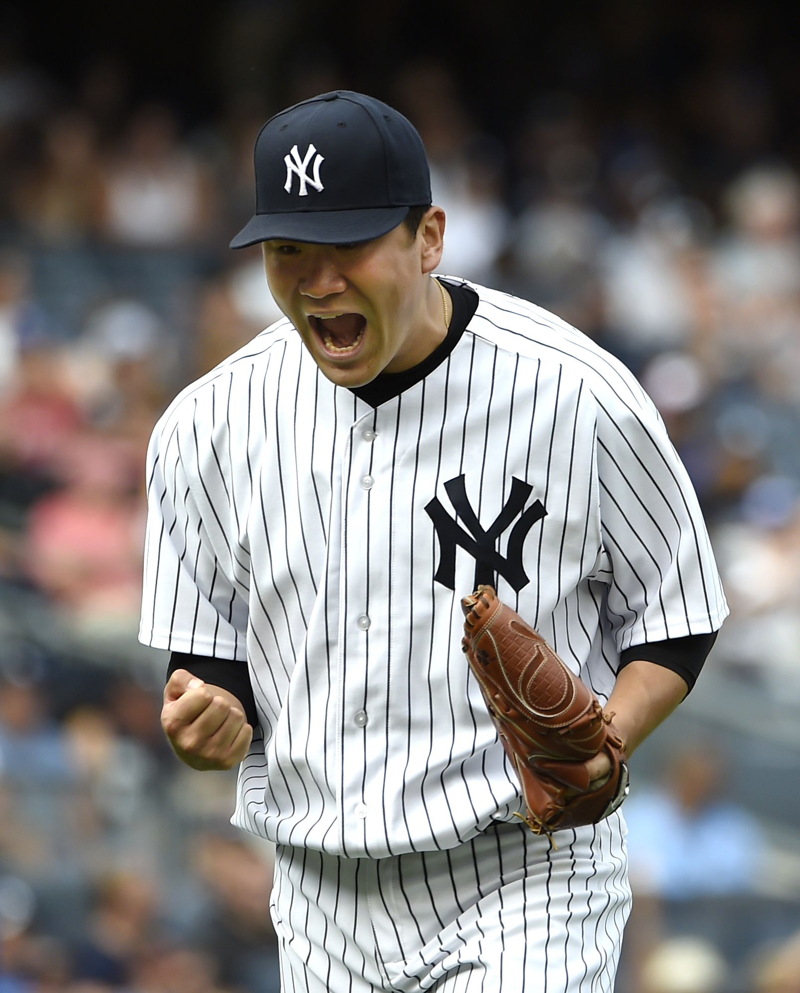 New York Yankees starting pitcher Masahiro Tanaka reacts after getting Toronto Blue Jays' Kevin Pillar to fly out for the third out in the seventh inning of a baseball game at Yankee Stadium, Sunday, Sept. 13, 2015, in New York. The Yankees won 5-0. (AP P