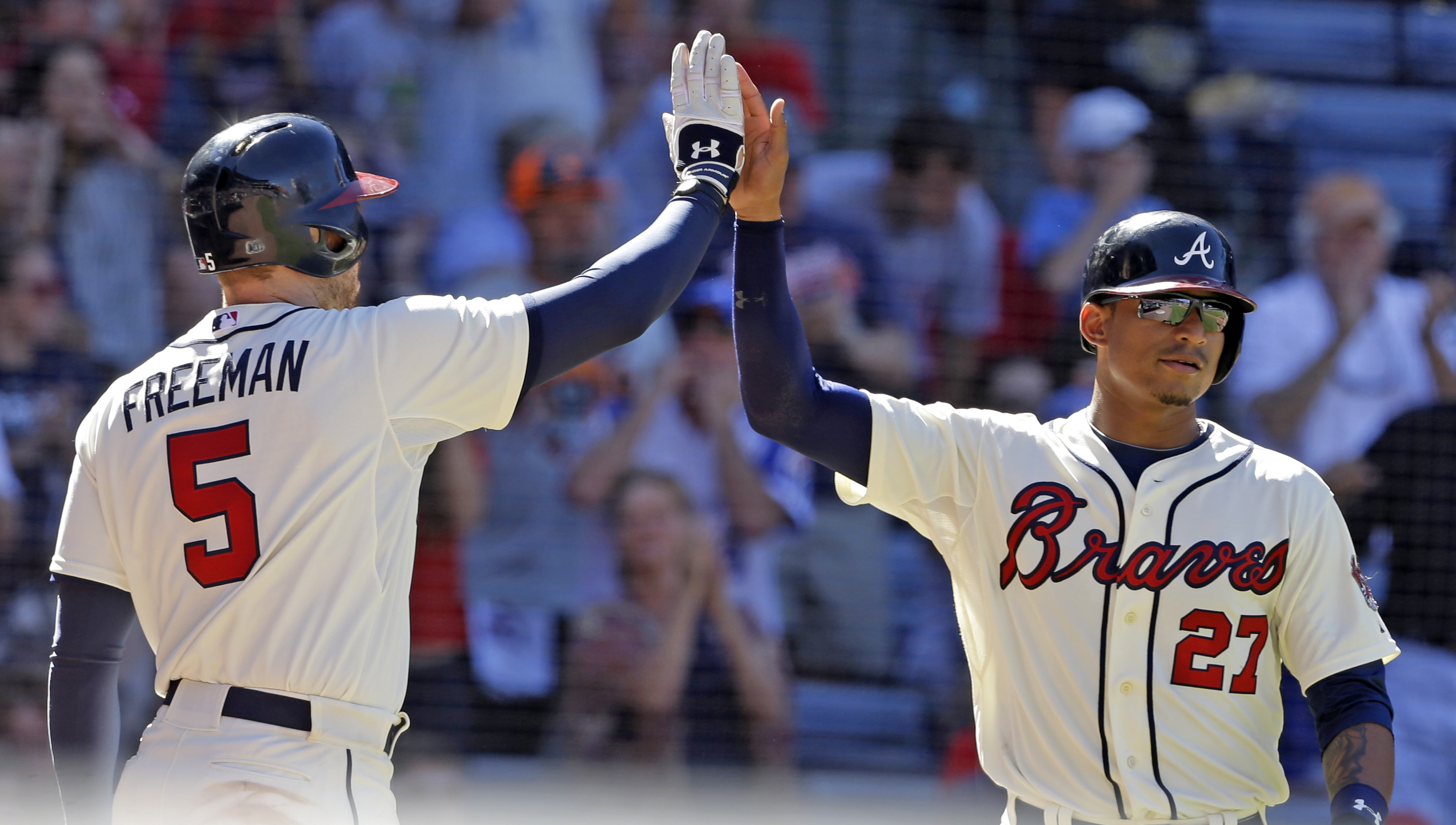 Atlanta Braves' Christian Bethancourt (27) celebrates with teammate Freddie Freeman (5) after scoring a run during the eighth inning of a baseball game against the New York Mets, Sunday, Sept. 13, 2015, in Atlanta. (AP Photo/Butch Dill)