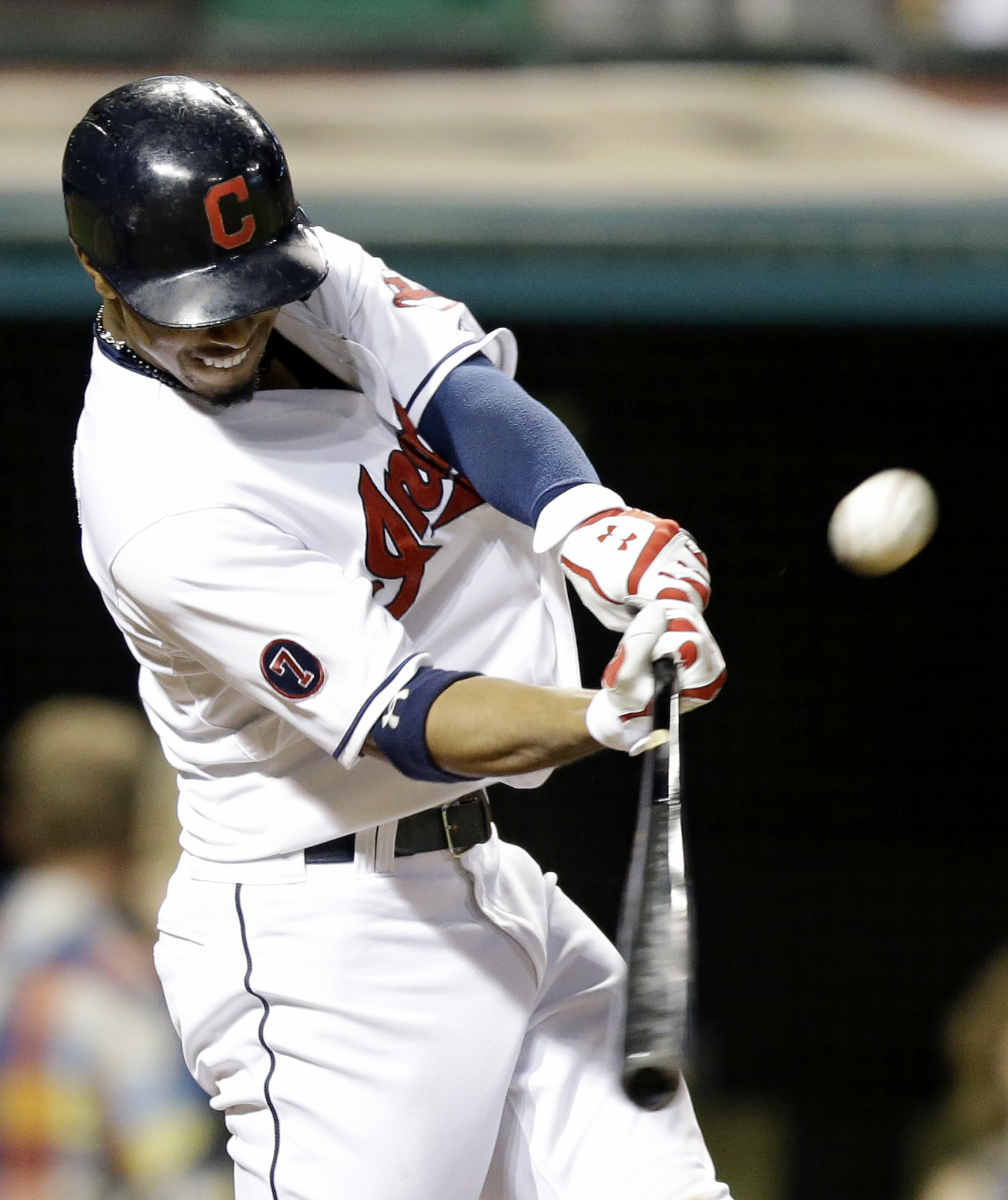 Cleveland Indians' Francisco Lindor hits an RBI-triple off Kansas City Royals relief pitcher Franklin Morales in the eighth inning of a baseball game, Monday, Sept. 14, 2015, in Cleveland. Jose Ramirez scored on the play. (AP Photo/Tony Dejak)