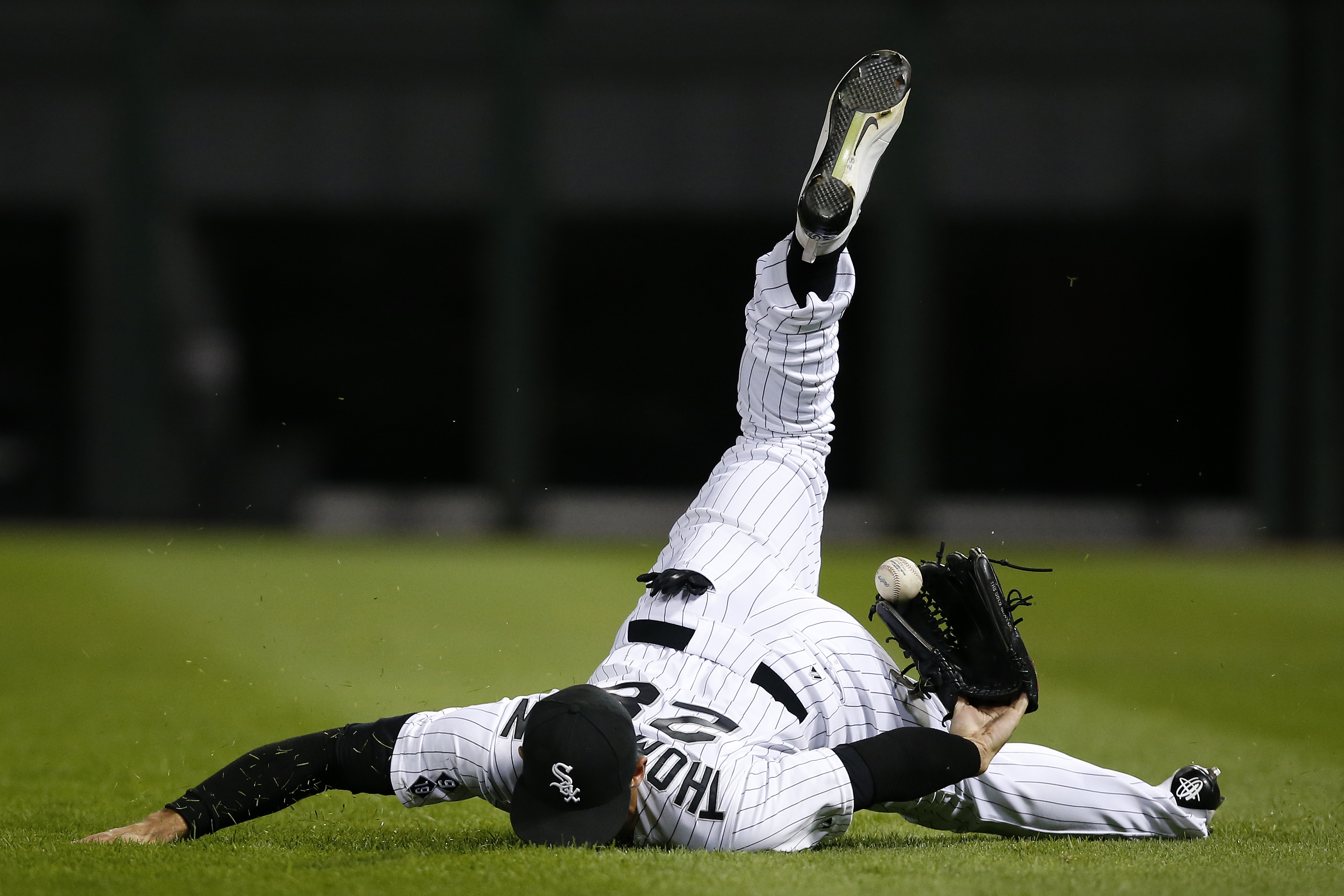 Chicago White Sox right fielder Trayce Thompson loses the ball on a double hit by Oakland Athletics' Brett Lawrie during the ninth inning of a baseball game, Monday, Sept. 14, 2015, in Chicago. (AP Photo/Andrew A. Nelles)
