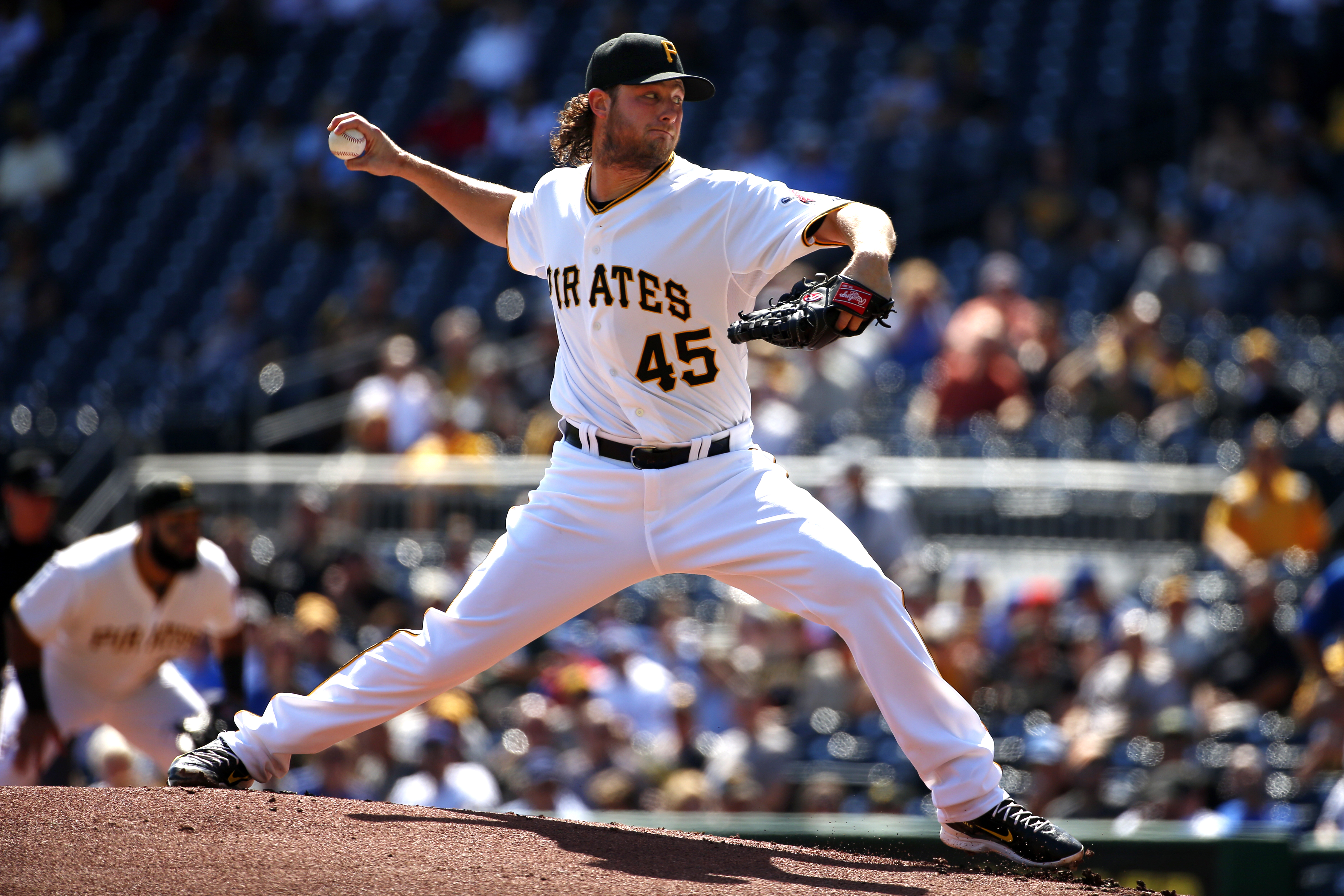 Pittsburgh Pirates starting pitcher Gerrit Cole delivers during the first inning of the first baseball game of a doubleheader against the Chicago Cubs, Tuesday, Sept. 15, 2015, in Pittsburgh. (AP Photo/Gene J. Puskar)