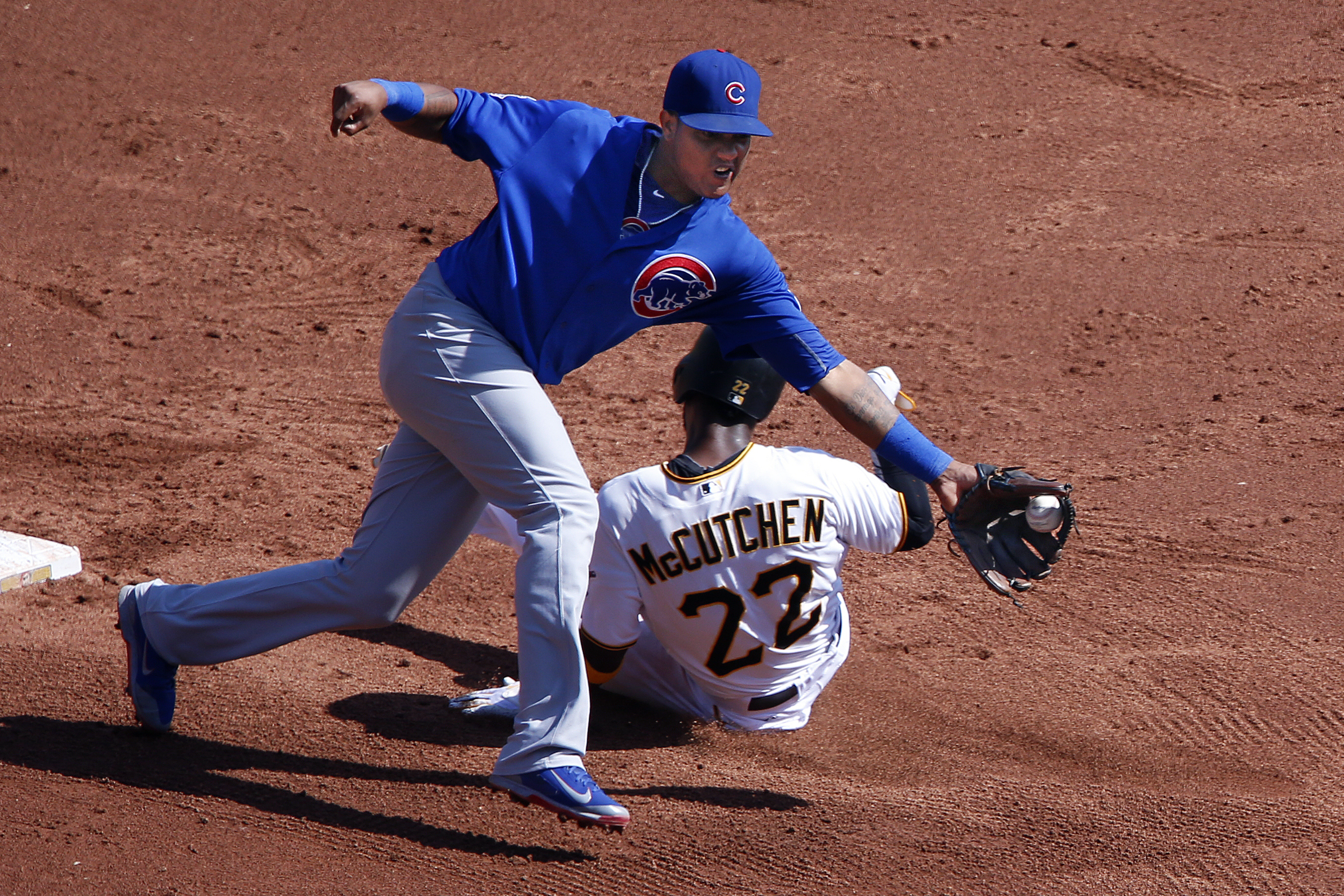 Chicago Cubs second baseman Starlin Castro reaches for a wide throw from catcher Miguel Montero as Pittsburgh Pirates' Andrew McCutchen (22) steals second during the third inning of the first baseball game of a doubleheader in Pittsburgh, Tuesday, Sept. 1