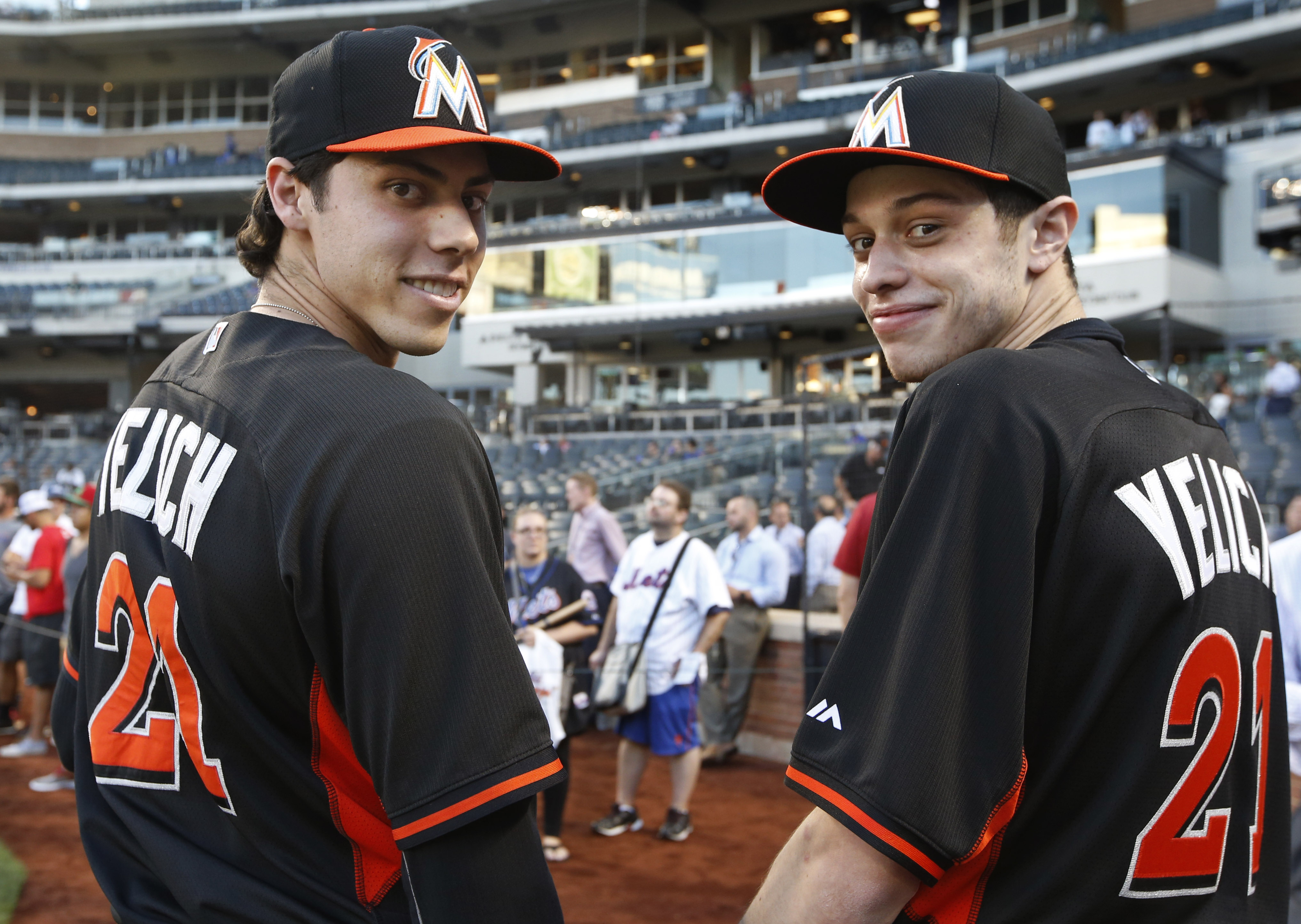 Miami Marlins' Christian Yelich, left, poses for a photograph with Saturday Night Live comedian Pete Davidson before a baseball game between the Marlins and the New York Mets, Tuesday, Sept. 15, 2015, in New York. (AP Photo/Kathy Willens)