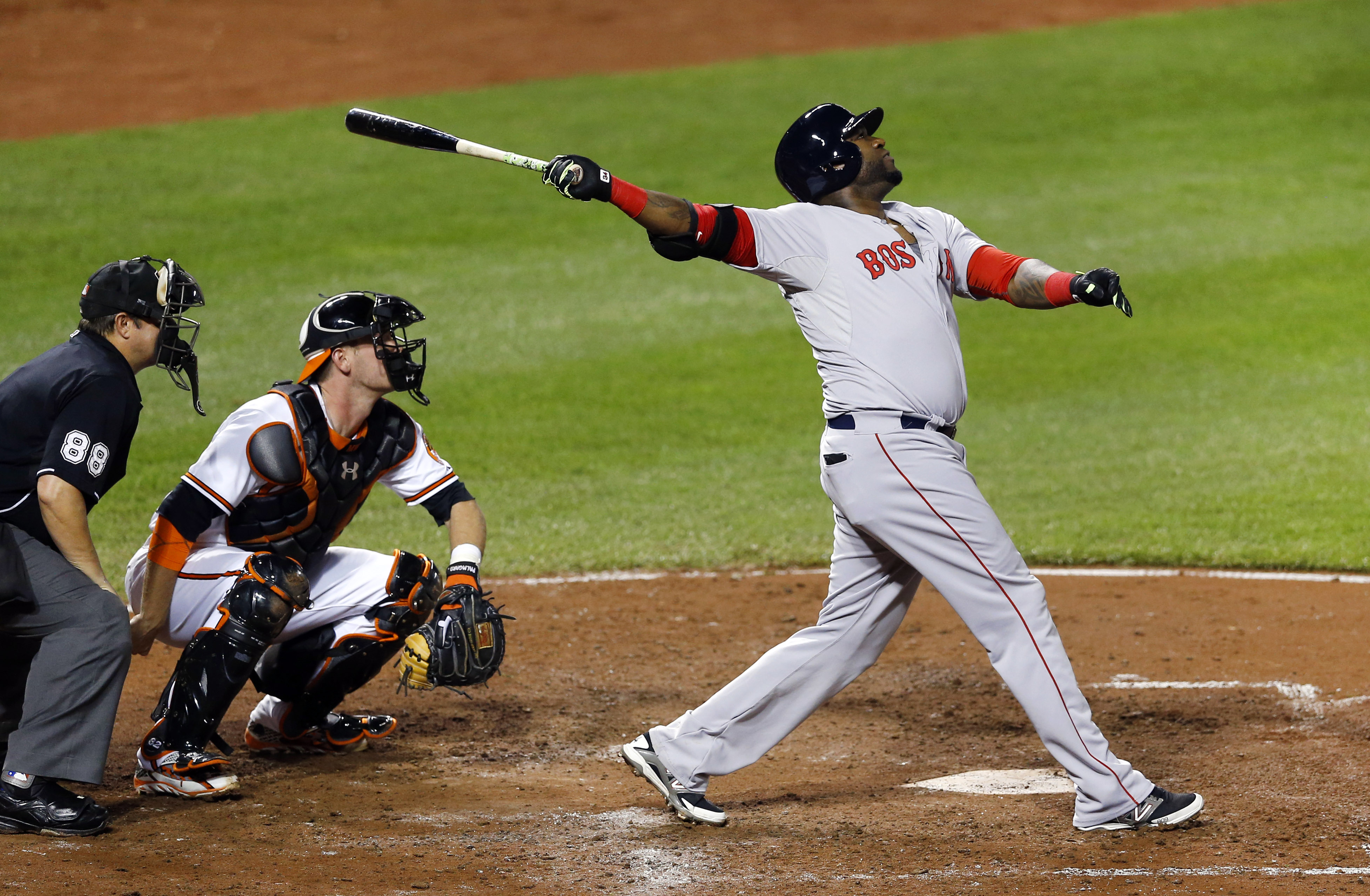 Boston Red Sox's David Ortiz watches his sacrifice fly ball in front of Baltimore Orioles catcher Matt Wieters and home plate umpire Doug Eddings in the fifth inning of a baseball game, Tuesday, Sept. 15, 2015, in Baltimore. Dustin Pedroia scored on the p
