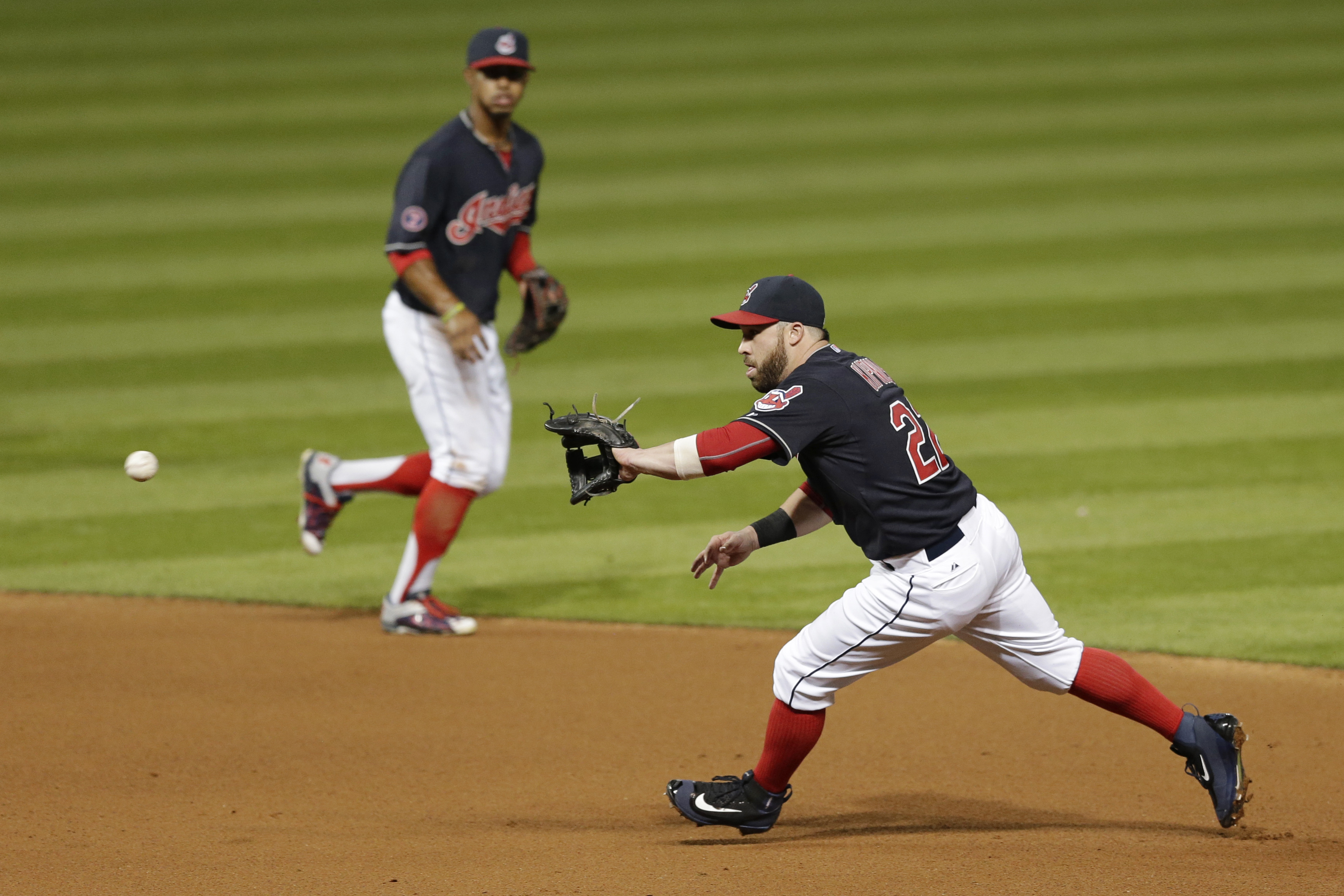 Cleveland Indians' Jason Kipnis, right, fields a ball hit by Kansas City Royals' Eric Hosmer during the fourth inning of a baseball game, Tuesday, Sept. 15, 2015, in Cleveland. Hosmer was out on the play. Francisco Lindor, left, watches. (AP Photo/Tony De
