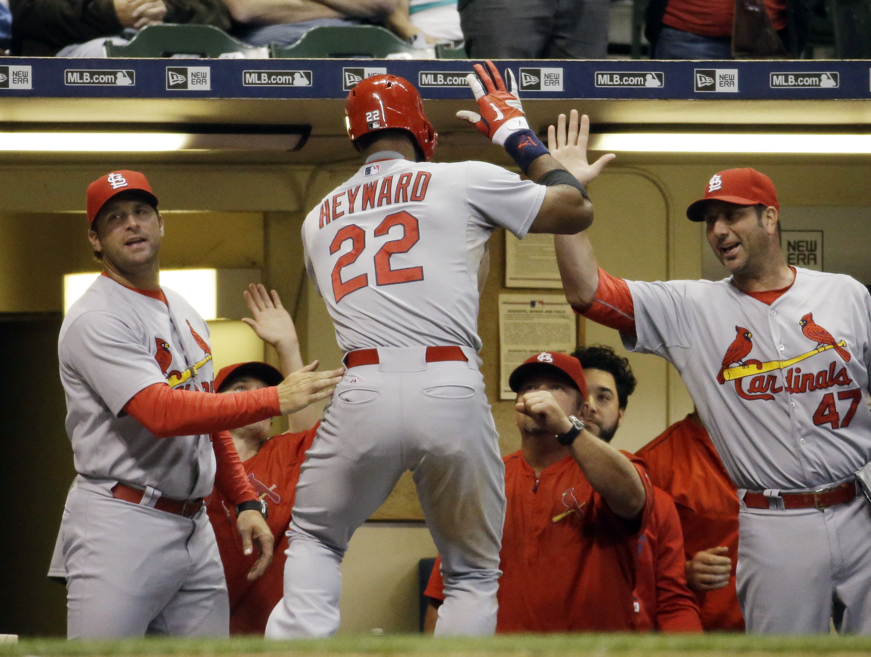 St. Louis Cardinals' Jason Heyward (22) is congratulated after hitting a two-run home run during the 10th inning of a baseball game against the Milwaukee Brewers Tuesday, Sept. 15, 2015, in Milwaukee. (AP Photo/Morry Gash)