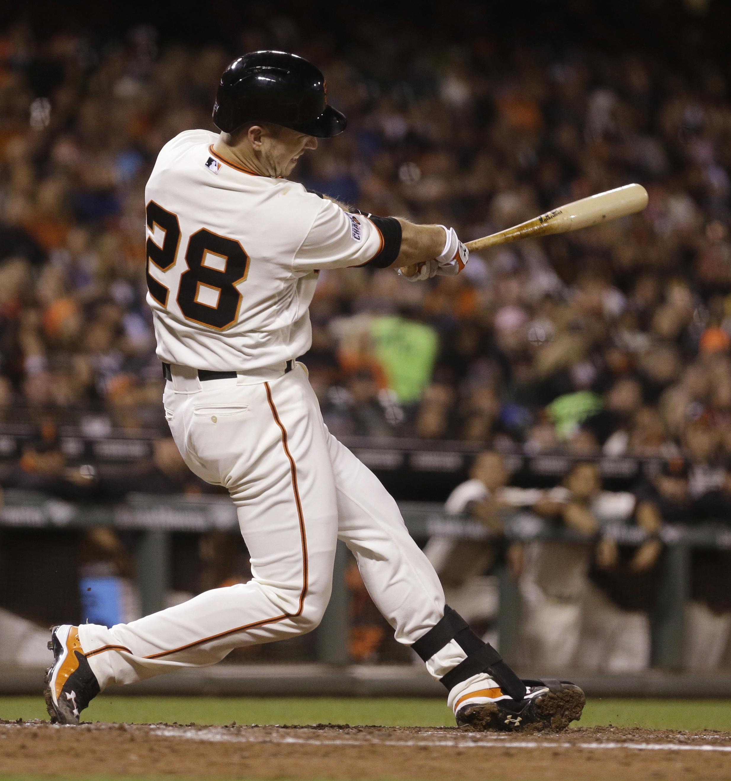 San Francisco Giants' Buster Posey follows through on a three-run home run off Cincinnati Reds' John Lamb during the fourth inning of a baseball game Tuesday, Sept. 15, 2015, in San Francisco. (AP Photo/Ben Margot)