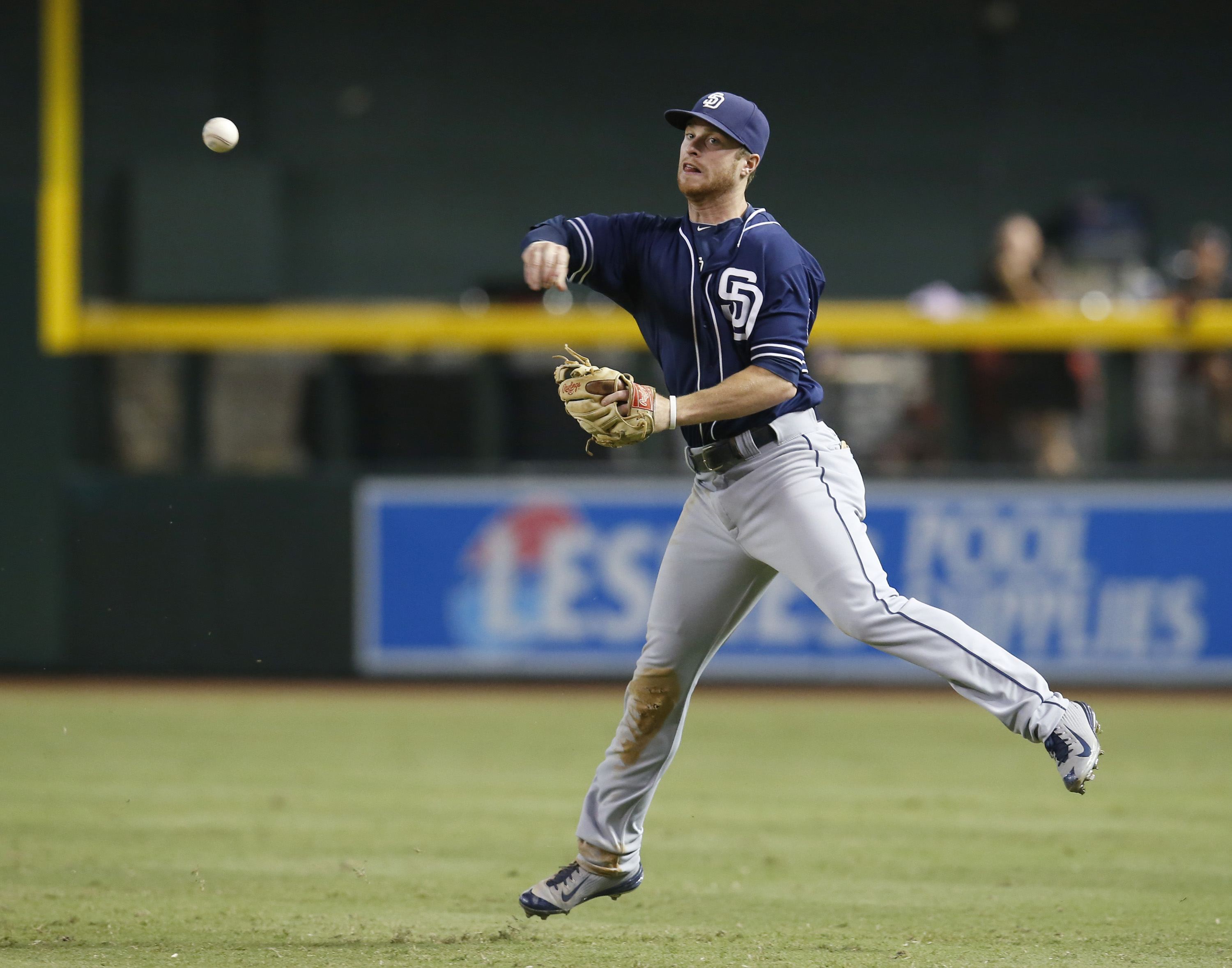 San Diego Padres second baseman Cory Spangenberg throws after fielding a grounder by Arizona Diamondbacks' Brandon Drury, who was safe at first with a single during the seventh inning of a baseball game, Tuesday, Sept. 15, 2015, in Phoenix. (AP Photo/Rick