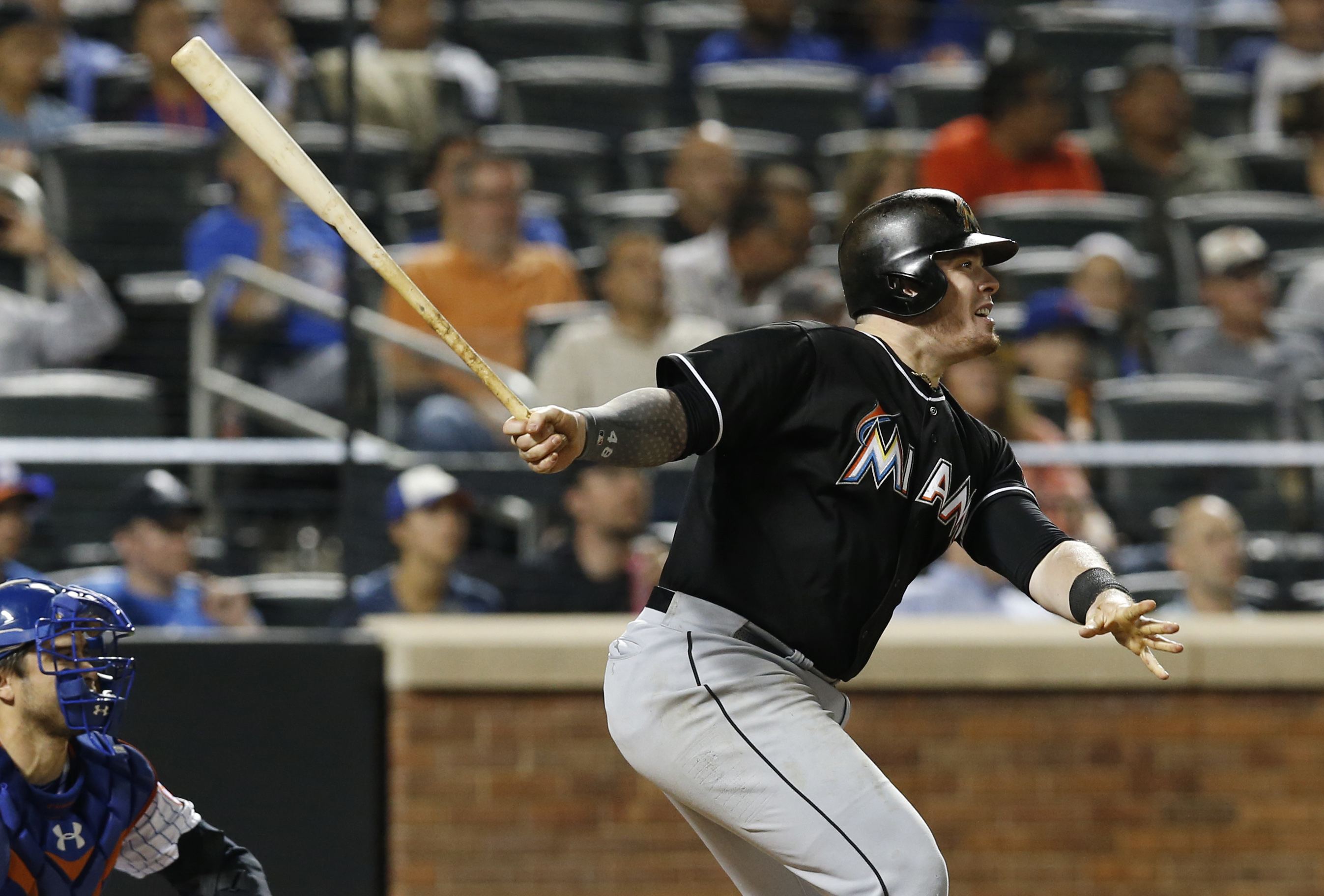 Miami Marlins' Justin Bour watches a sixth-inning sacrifice fly in a baseball game against the New York Mets in New York, Wednesday, Sept. 16, 2015. (AP Photo/Kathy Willens)