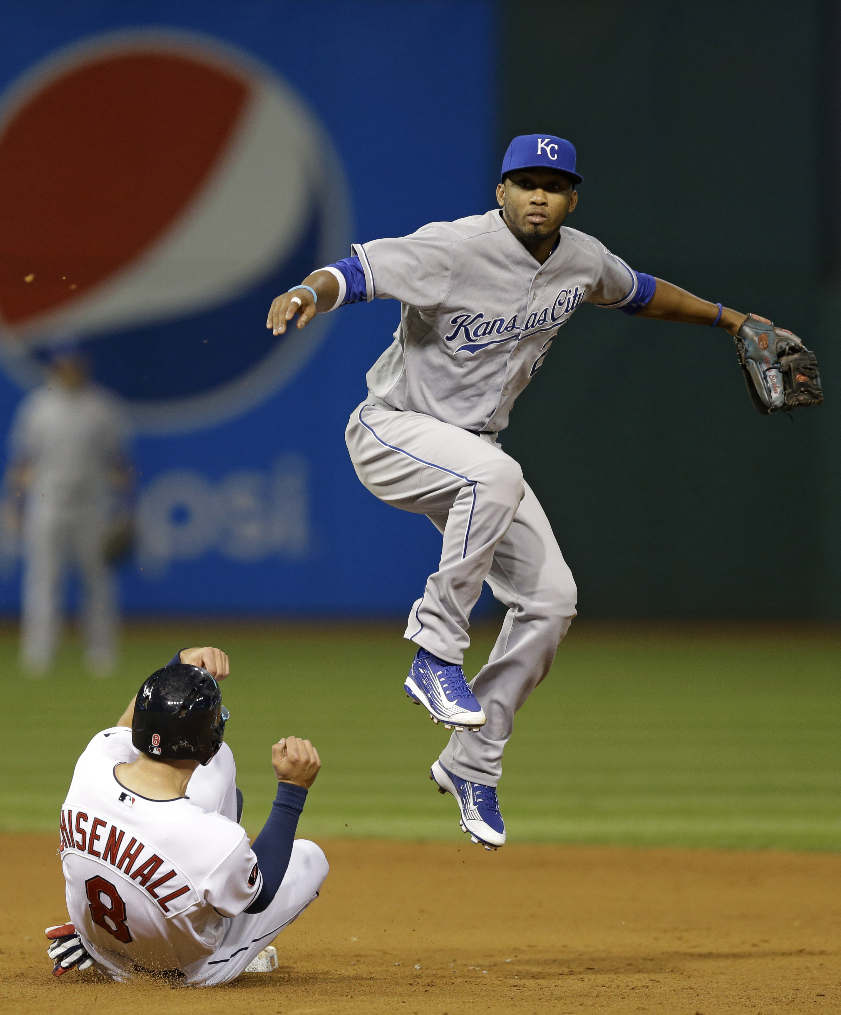 Kansas City Royals' Alcides Escobar looks toward first base after getting Cleveland Indians' Lonnie Chisenhall out at second base in the eighth inning of a baseball game, Wednesday, Sept. 16, 2015, in Cleveland. Abraham Almonte was safe at first base. The