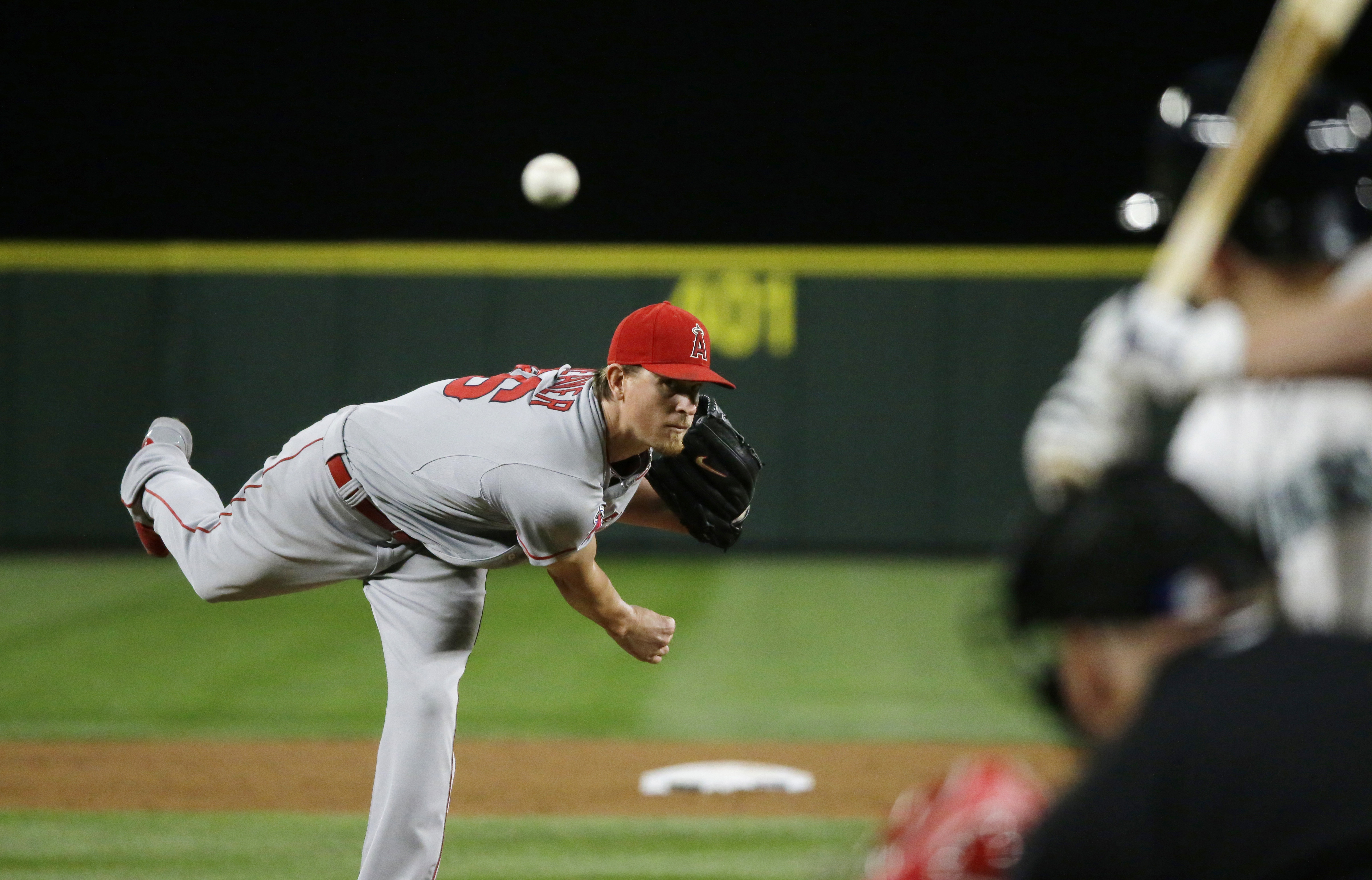 Los Angeles Angels starting pitcher Jered Weaver throws a pitch that hit Seattle Mariners' Kyle Seager, right, duriong the fifth inning of a baseball game, Wednesday, Sept. 16, 2015, in Seattle. Weaver was ejected from the game by home plate umpire Brian