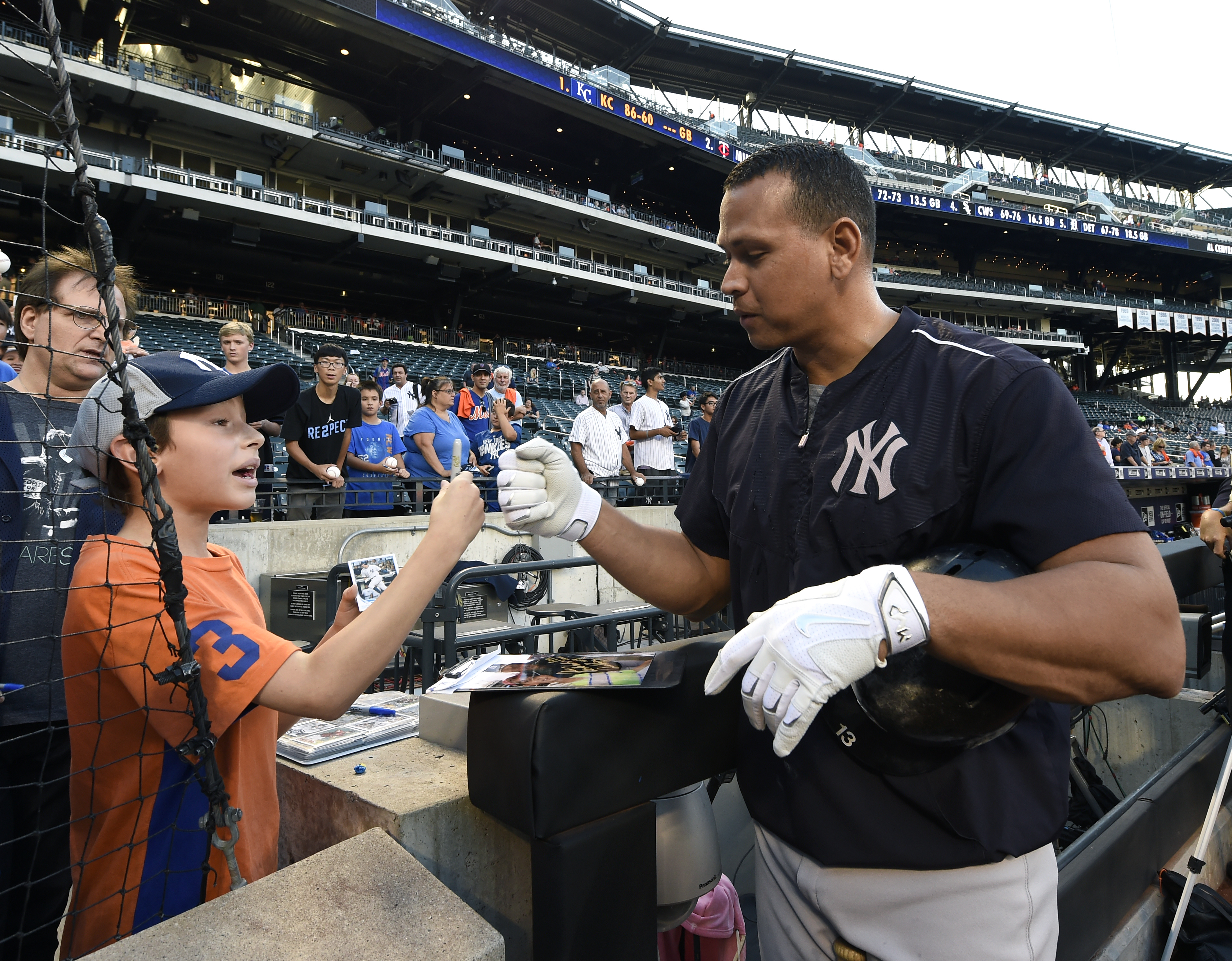New York Yankees' Alex Rodriguez pumps fists with Alex Weissman, 11, of Livingston, N.J. after signing an autograph for him during batting practice before the  interleague baseball game between the Yankees and the New York Mets at Citi Field, Friday, Sept