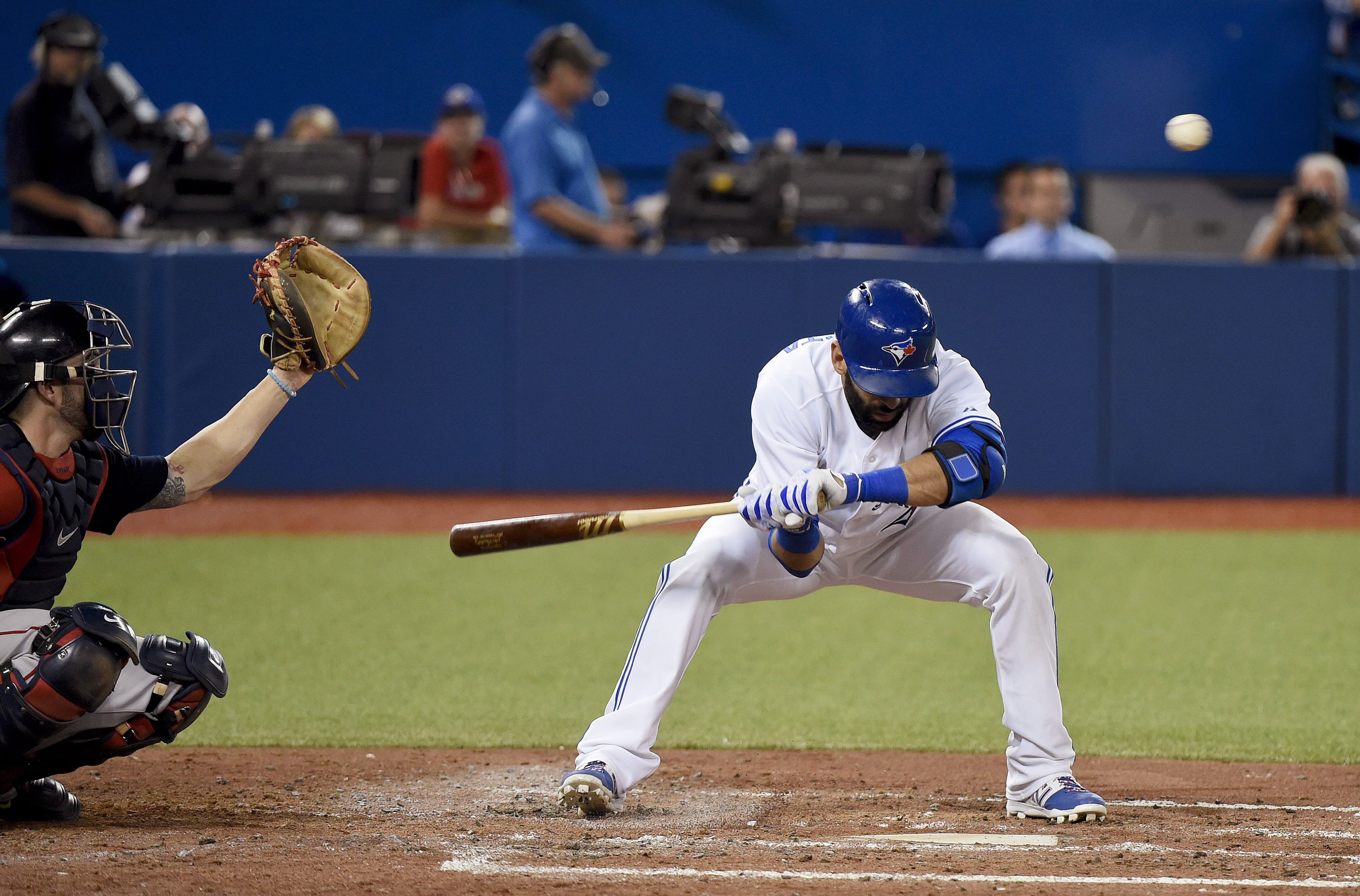 Toronto Blue Jays' Jose Bautista ducks away from a high, inside pitch by the Boston Red Sox during the fourth inning of a baseball game Friday, Sept. 18, 2015, in Toronto. (Nathan Denette/The Canadian Press via AP)