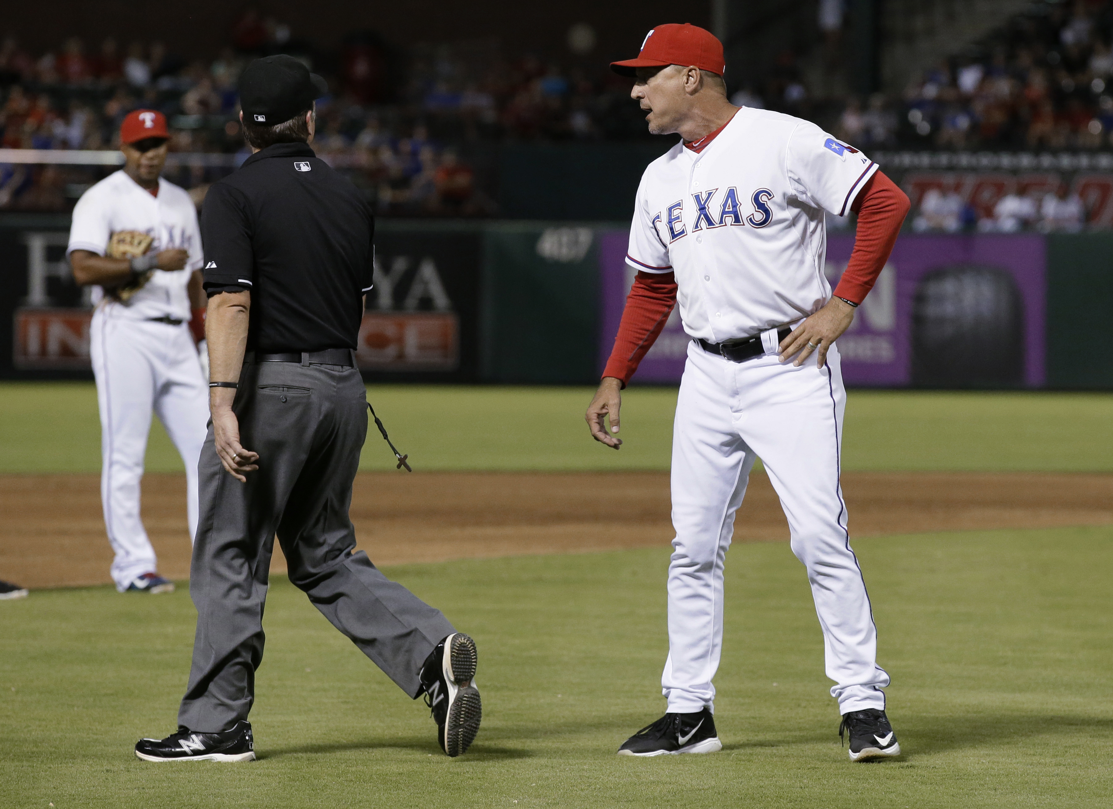 Texas Rangers manager Jeff Banister, right, yells at umpire Anthony Johnson during the second inning of a baseball game against the Seattle Mariners in Arlington, Texas, Friday, Sept. 18, 2015. (AP Photo/LM Otero)