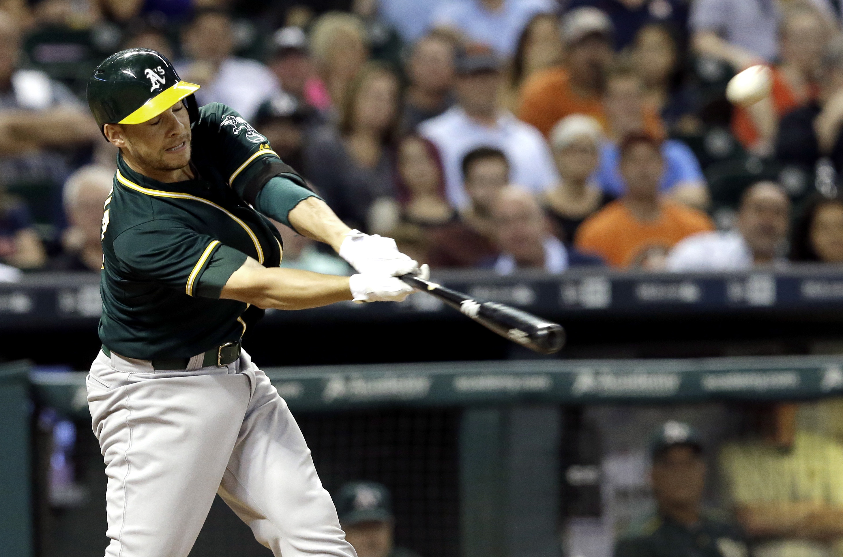 Oakland Athletics' Danny Valencia connects for a home run, his second of the game, against the Houston Astros in the eighth inning of a baseball game Friday, Sept. 18, 2015, in Houston. (AP Photo/Pat Sullivan)