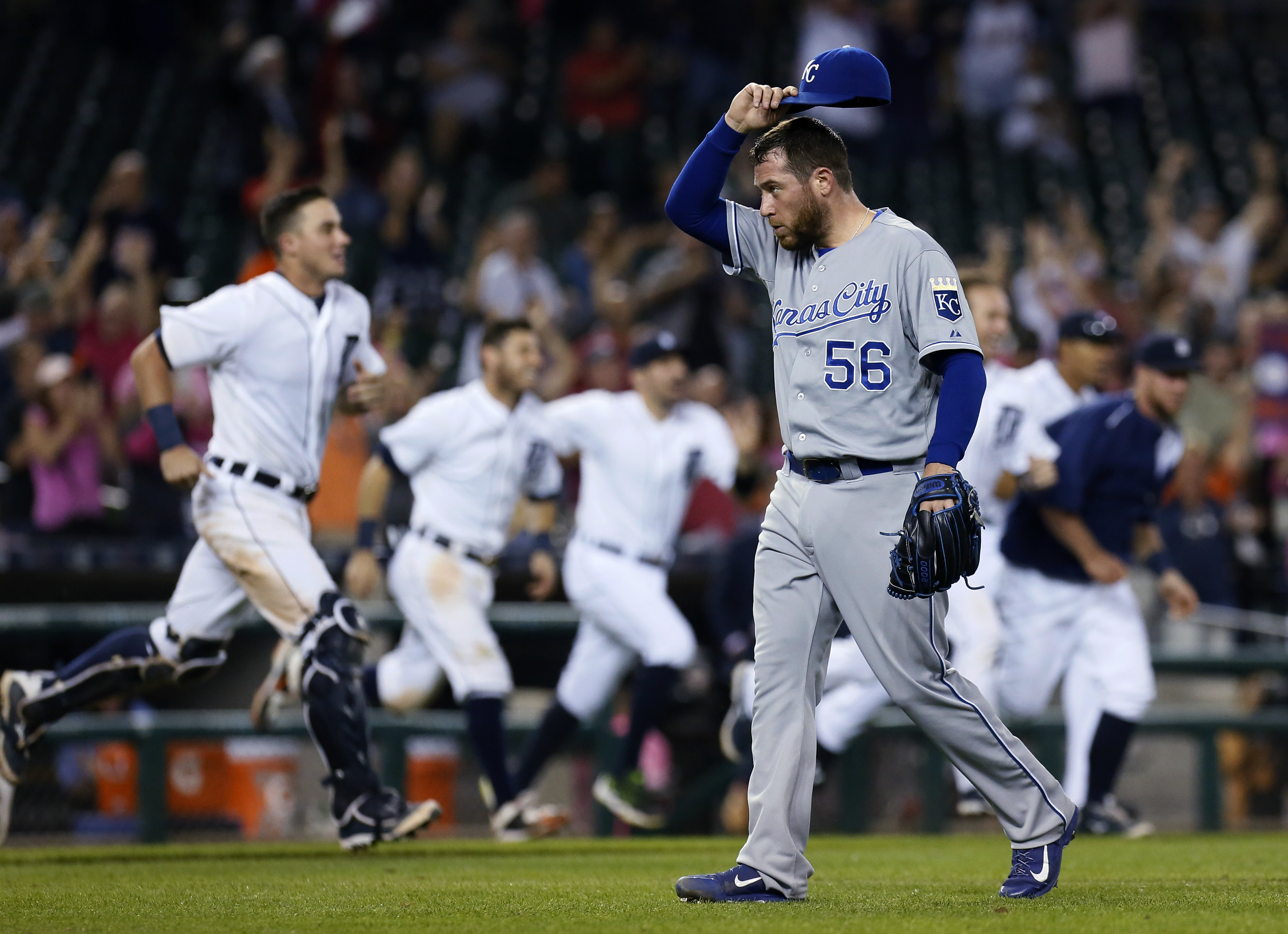 Kansas City Royals pitcher Greg Holland (56) walks off the field after giving up a game-winning RBI single to Detroit Tigers' Dixon Machado during the 12th inning of a baseball game Friday, Sept. 18, 2015, in Detroit. The Tigers defeated the Royals 5-4. (