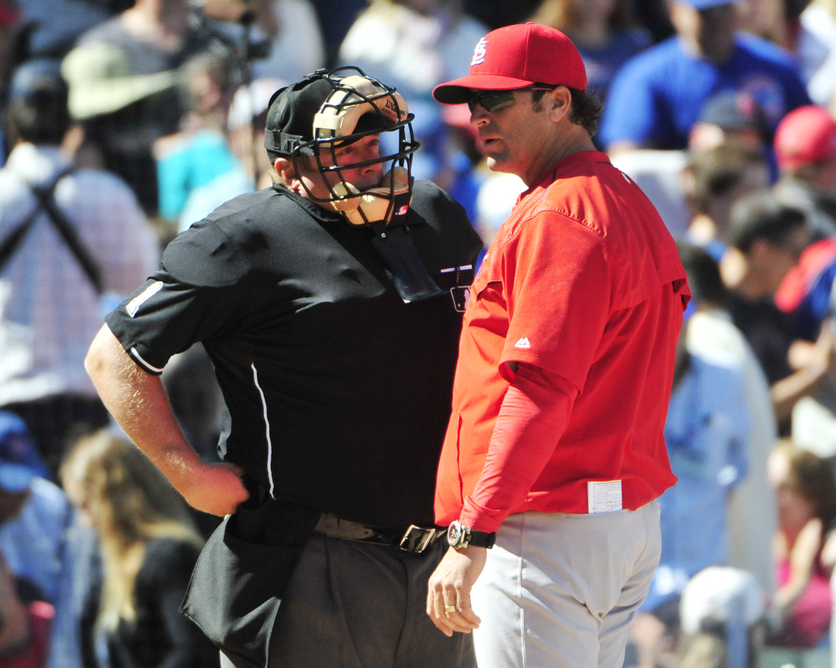 St. Louis Cardinals manager Mike Matheny, right, questions a call with home plate umpire Bruce Dreckman during the fifth inning of a baseball game against the Chicago Cubs, Saturday, Sept. 19, 2015, in Chicago. (AP Photo/David Banks)