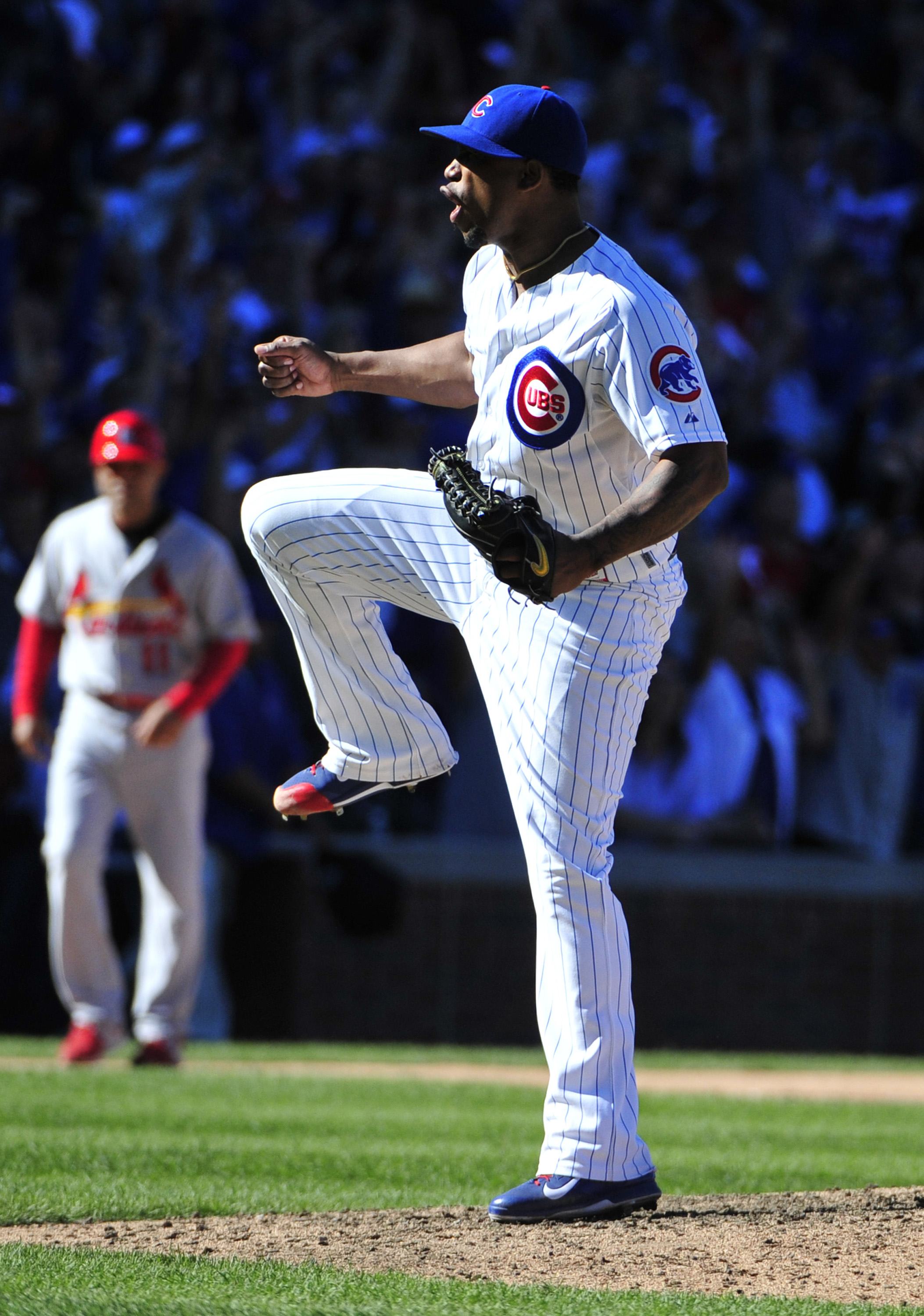 Chicago Cubs relief pitcher Pedro Strop (46) reacts after getting St. Louis Cardinals' Stephen Piscotty (55) to ground into a fielders choice to end the game during the ninth inning of a baseball game, Saturday, Sept. 19, 2015, in Chicago. The Cubs won 5-
