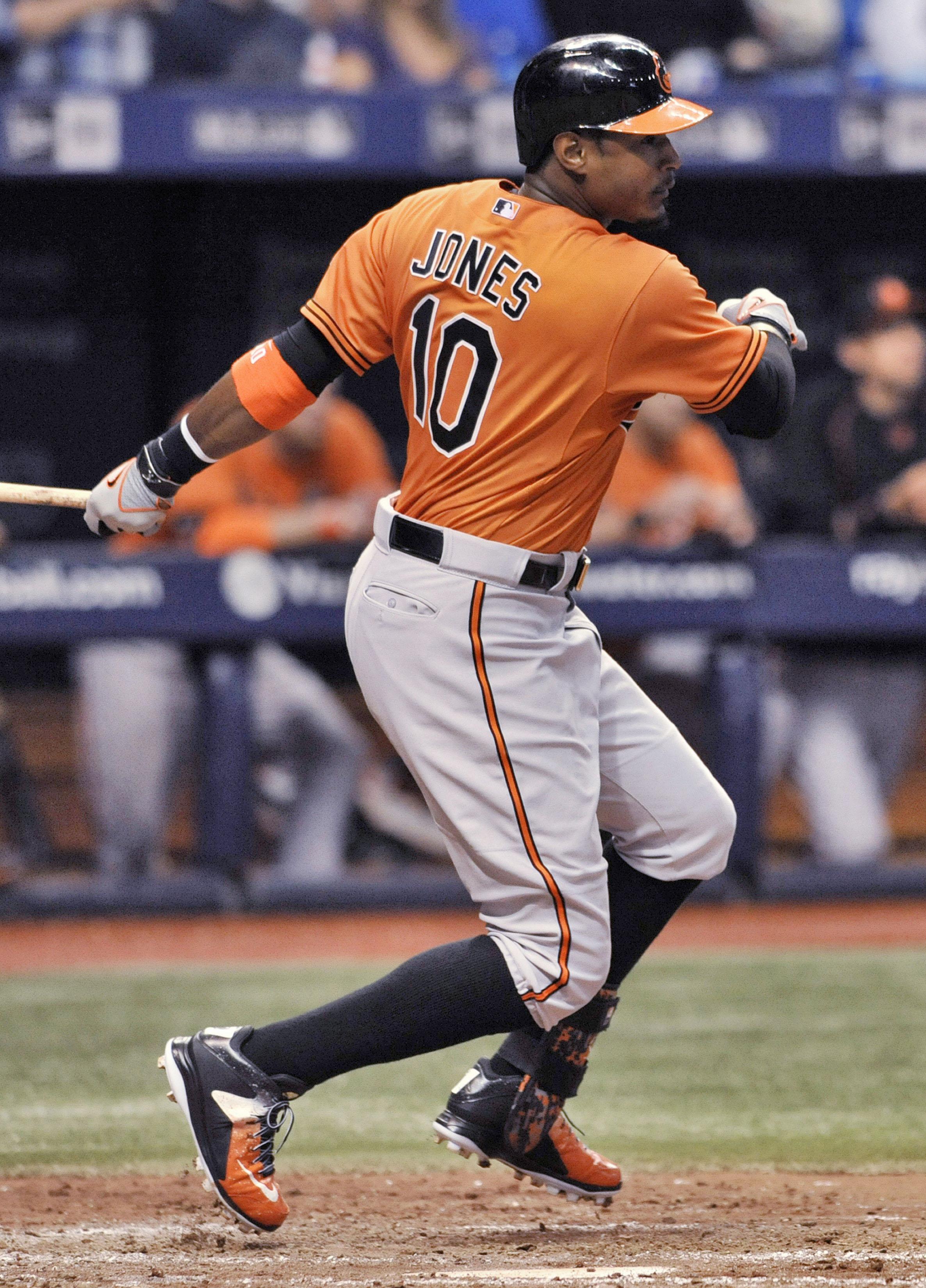 Baltimore Orioles' Adam Jones hits an RBI-single off Tampa Bay Rays' Erasmo Ramirez during the sixth inning of a baseball game Saturday, Sept. 19, 2015, in St. Petersburg, Fla. (AP Photo/Steve Nesius)