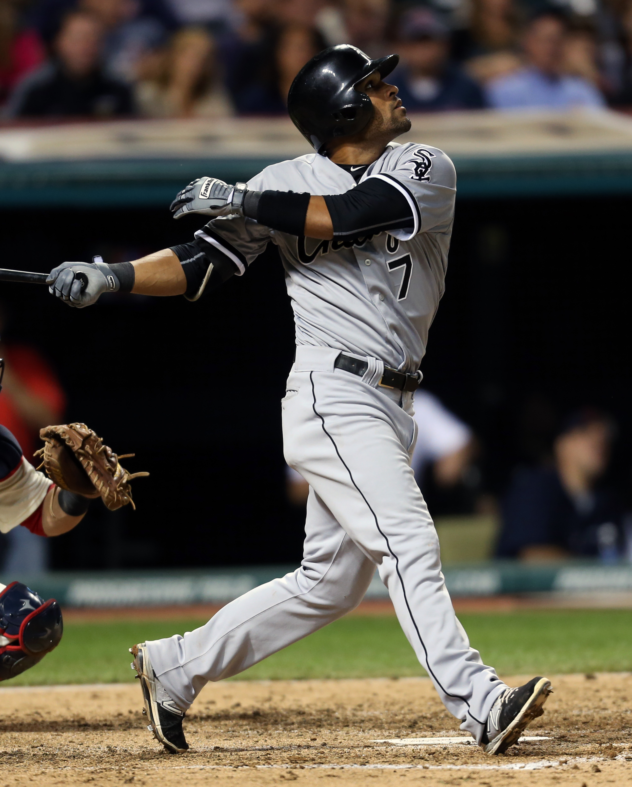 Chicago White Sox's Micah Johnson hits an RBI single off Cleveland Indians starting pitcher Carlos Carrasco during the fifth inning of a baseball game, Saturday, Sept. 19, 2015, in Cleveland. (AP Photo/Ron Schwane)