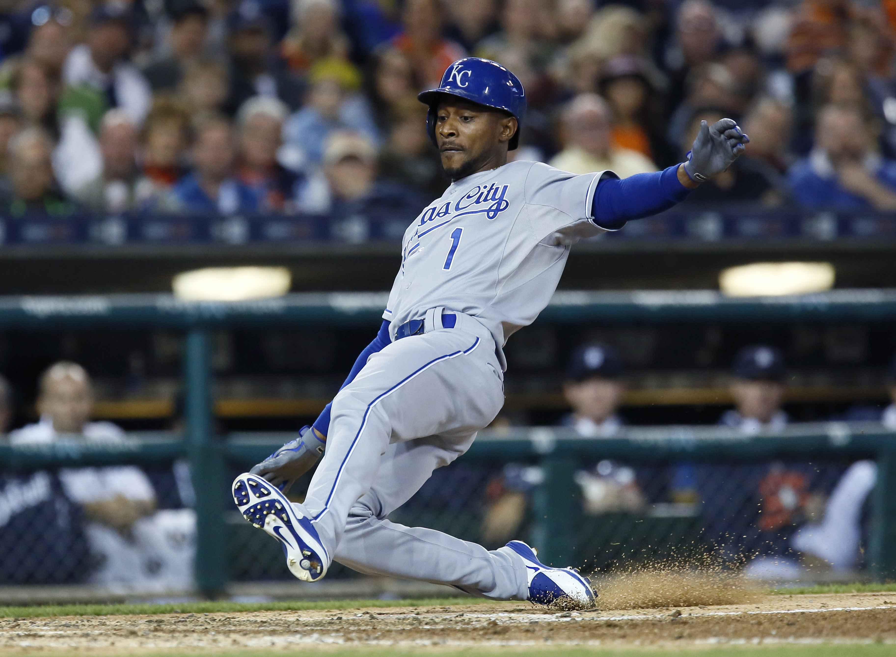 Kansas City Royals' Jarrod Dyson (1) scores against the Detroit Tigers on a single by Christian Colon during the seventh inning of a baseball game at Comerica Park, Saturday, Sept. 19, 2015, in Detroit. (AP Photo/Duane Burleson)
