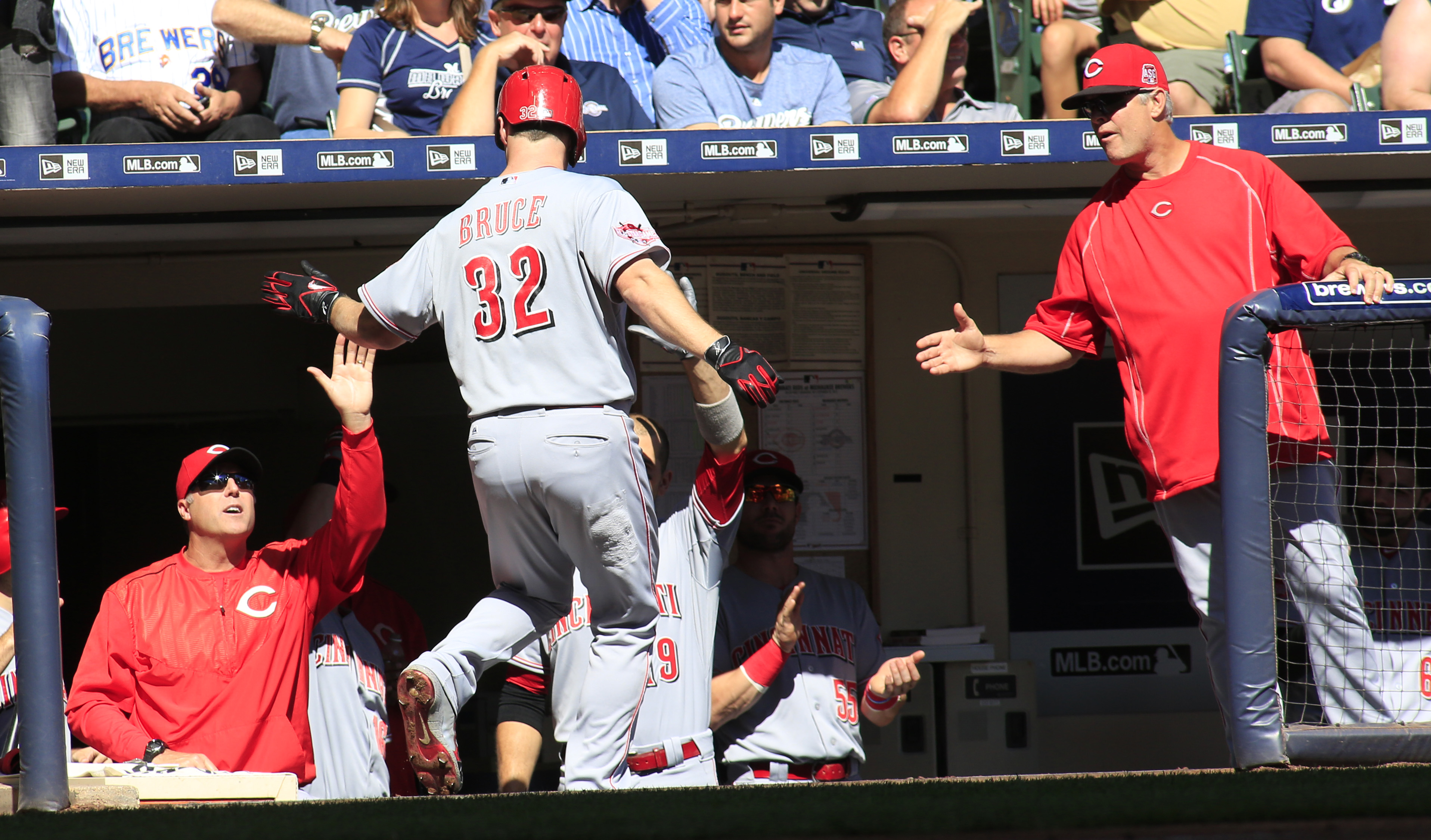 Cincinnati Reds' Jay Bruce is congratulated by teammates after hitting a solo home run against the Milwaukee Brewers during the second inning of a baseball game Sunday, Sept. 20, 2015, in Milwaukee. (AP Photo/Darren Hauck)