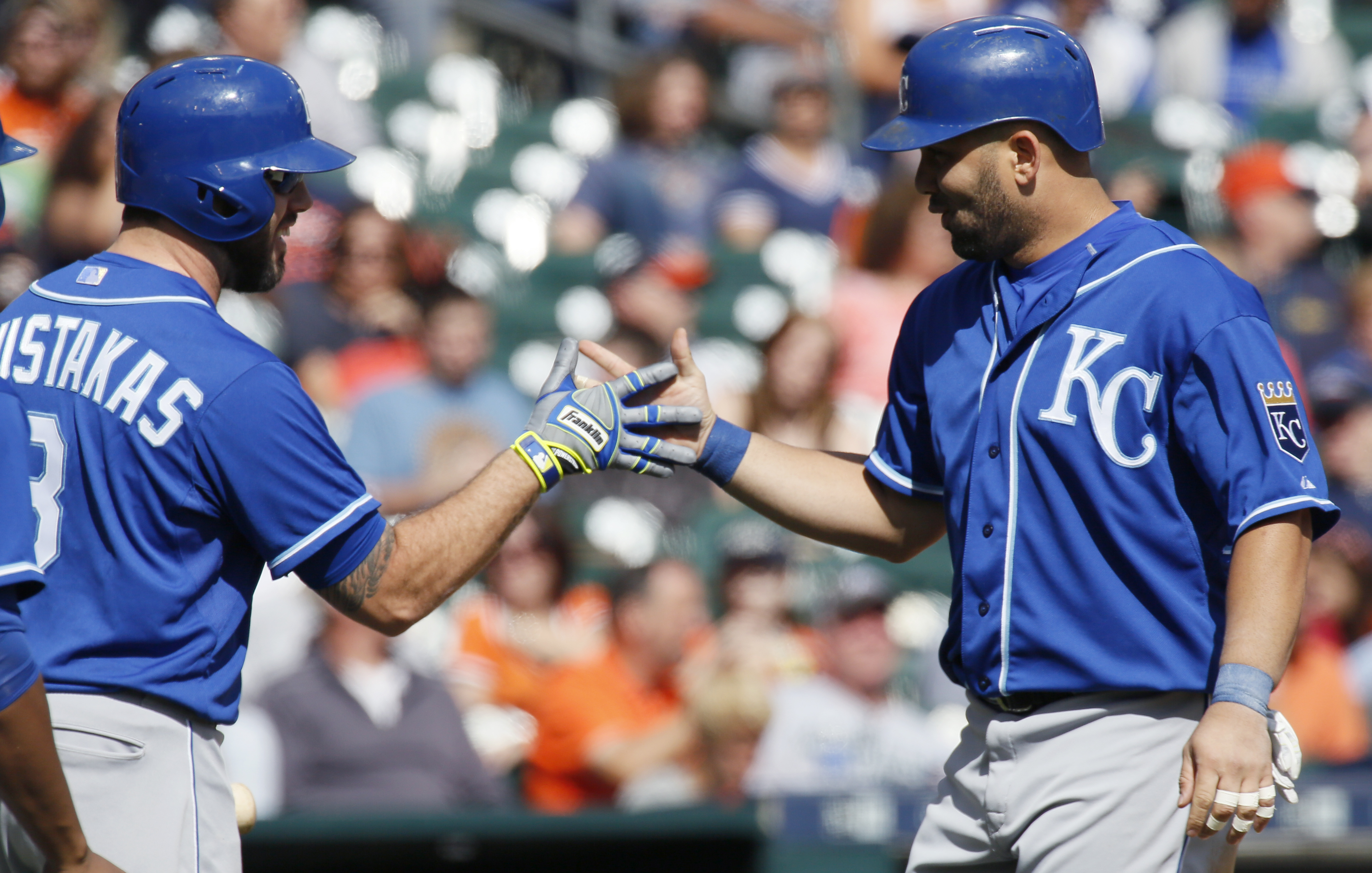 Kansas City Royals' Kendrys Morales, right, is congratulated by Mike Moustakas (8) after hitting a solo home run against the Detroit Tigers during the fourth inning of a baseball game at Comerica Park, Sunday, Sept. 20, 2015, in Detroit. (AP Photo/Duane B