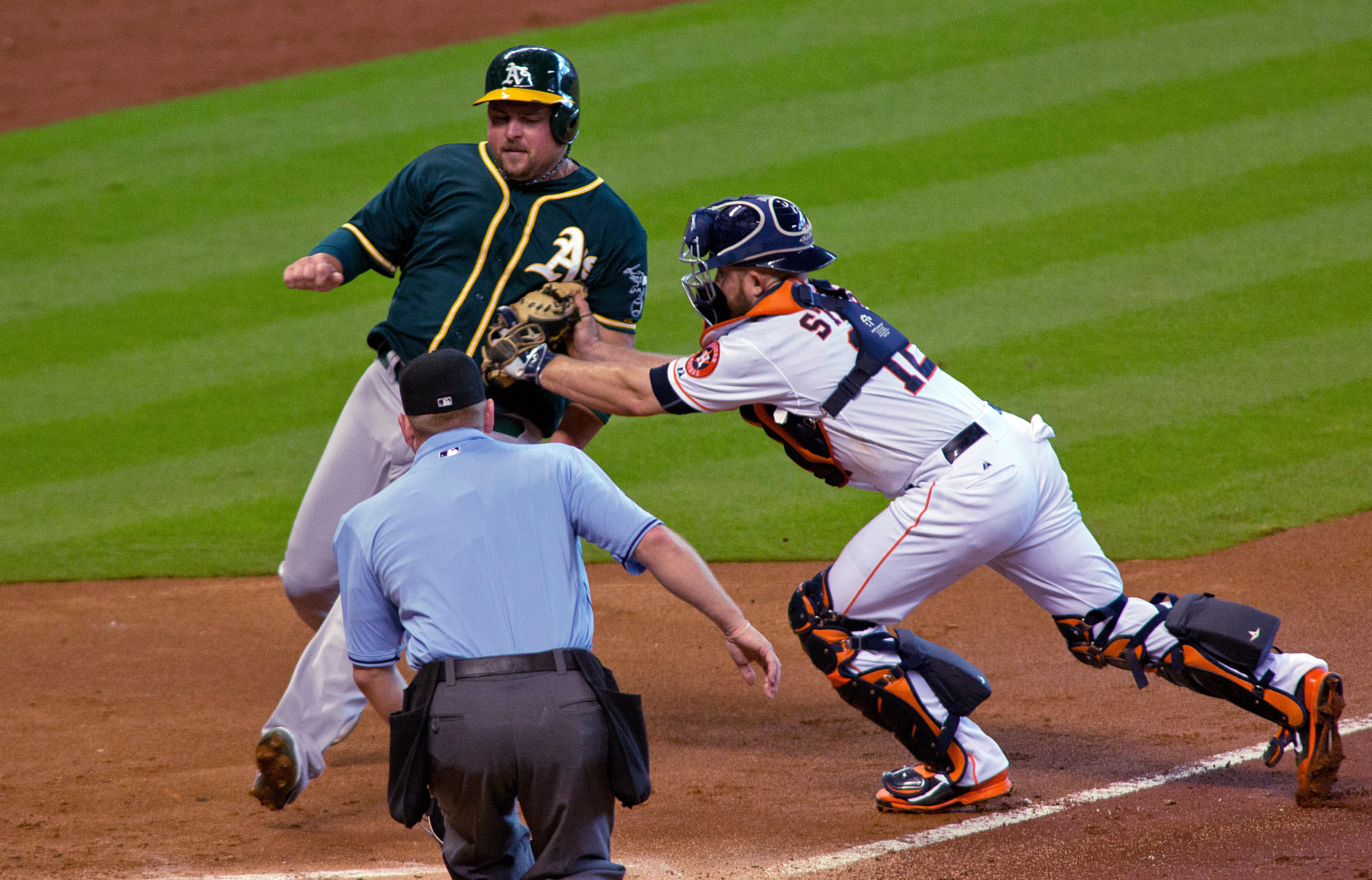 Oakland Athletics Billy Butler is tagged out at home by Houston Astros catcher Max Stassi in the second inning of a baseball game Sunday, Sept. 20, 2015, in Houston. (AP Photo/Richard Carson)