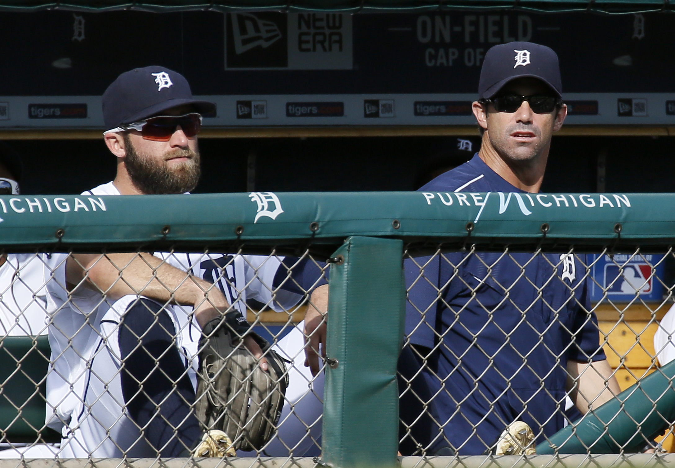 Detroit Tigers' Tyler Collins, left, and manager Brad Ausmus looks out from the dugout during the ninth inning of a 10-3 loss to the Kansas City Royals in a baseball game at Comerica Park Sunday, Sept. 20, 2015, in Detroit. (AP Photo/Duane Burleson)
