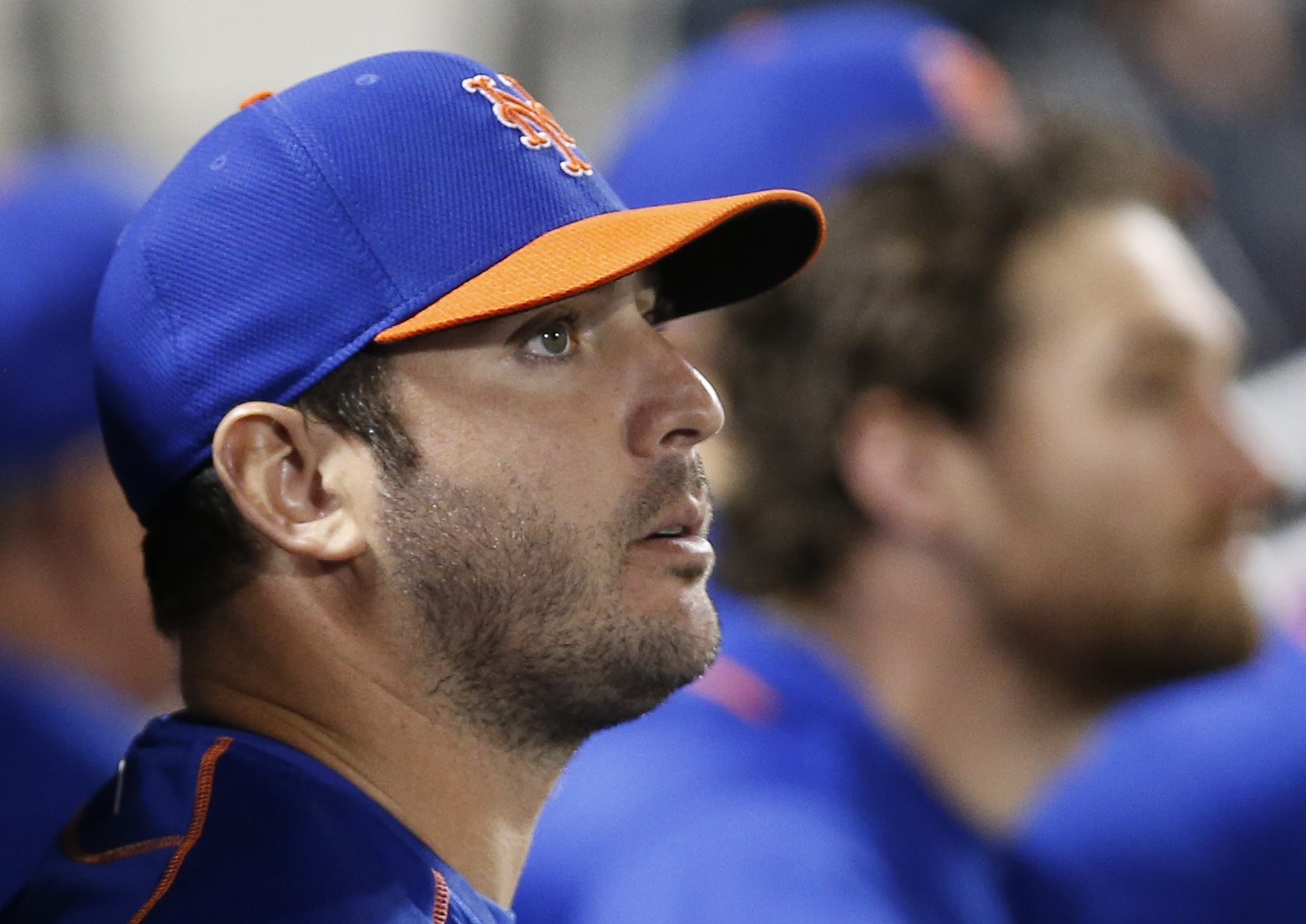 New York Mets starting pitcher Matt Harvey watches from the dugout in the ninth inning of the Mets' 11-2 loss to the New York Yankees in a baseball game in New York, Sunday, Sept. 20, 2015. (AP Photo/Kathy Willens)