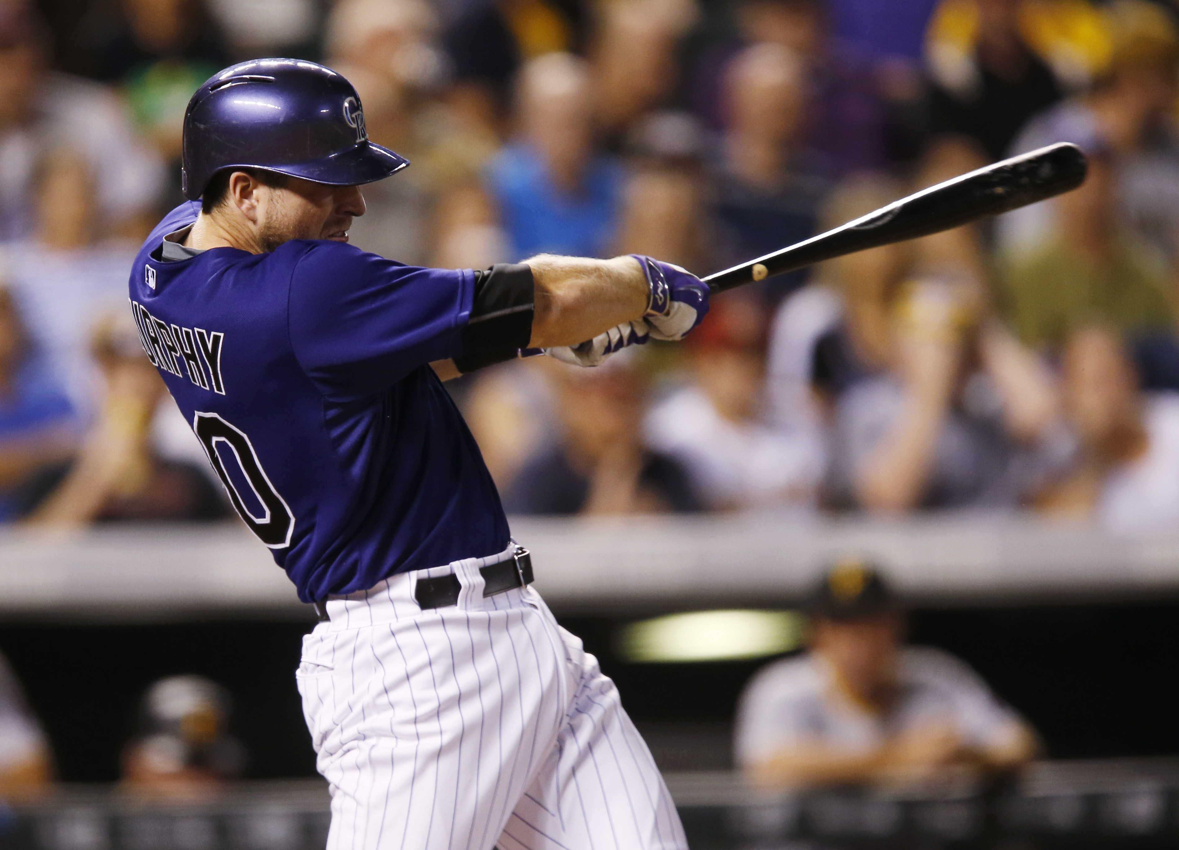 Colorado Rockies' Tom Murphy connects for a three-run home run off Pittsburgh Pirates starting pitcher A.J. Burnett in the fifth inning of a baseball game, Monday, Sept. 21, 2015, in Denver. (AP Photo/David Zalubowski)