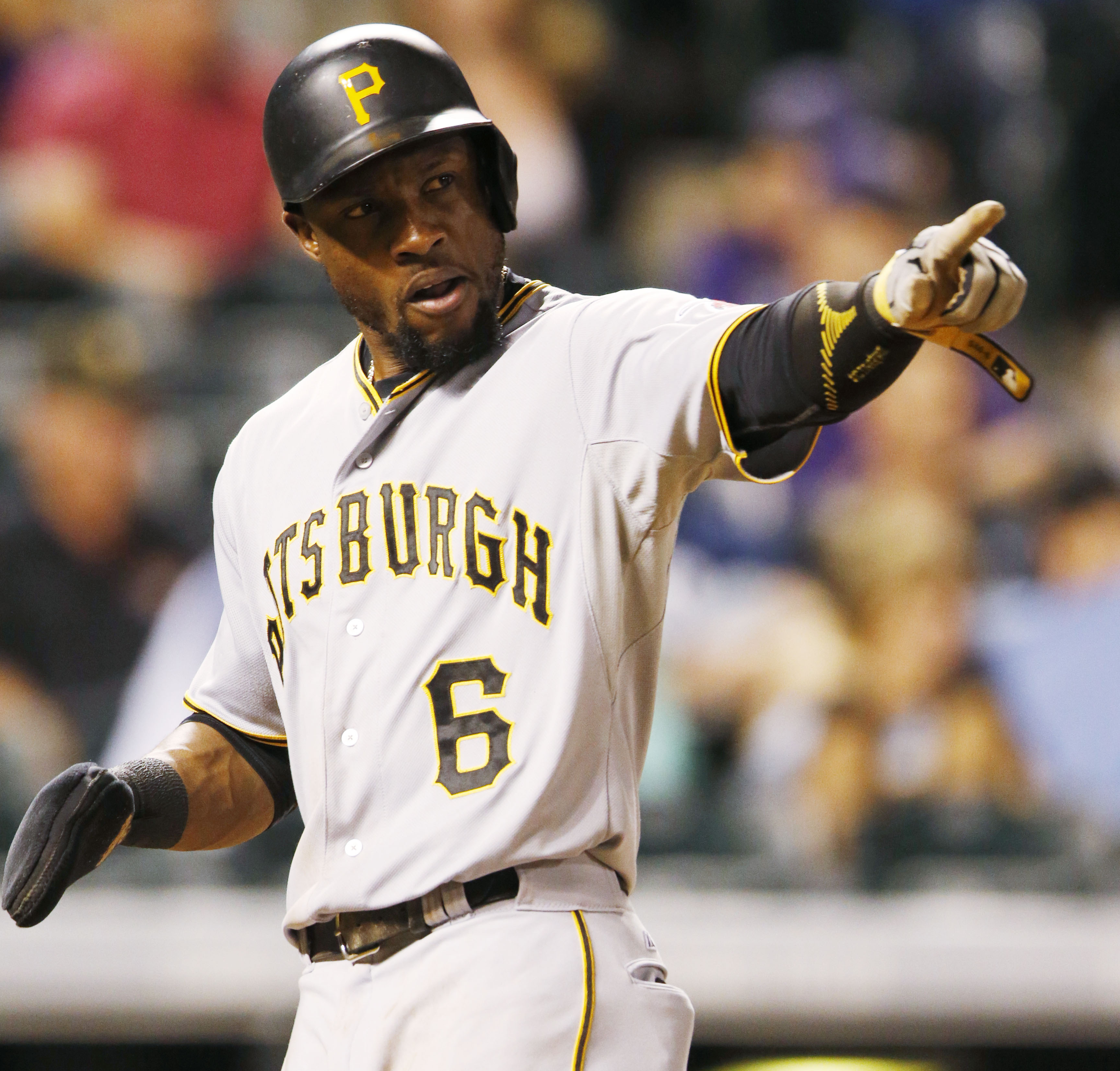 Pittsburgh Pirates' Starling Marte points to Aramis Ramirez after he singled to drive in Marte against the Colorado Rockies in the ninth inning of a baseball game Monday, Sept. 21, 2015, in Denver. Pittsburgh won 9-3. (AP Photo/David Zalubowski)