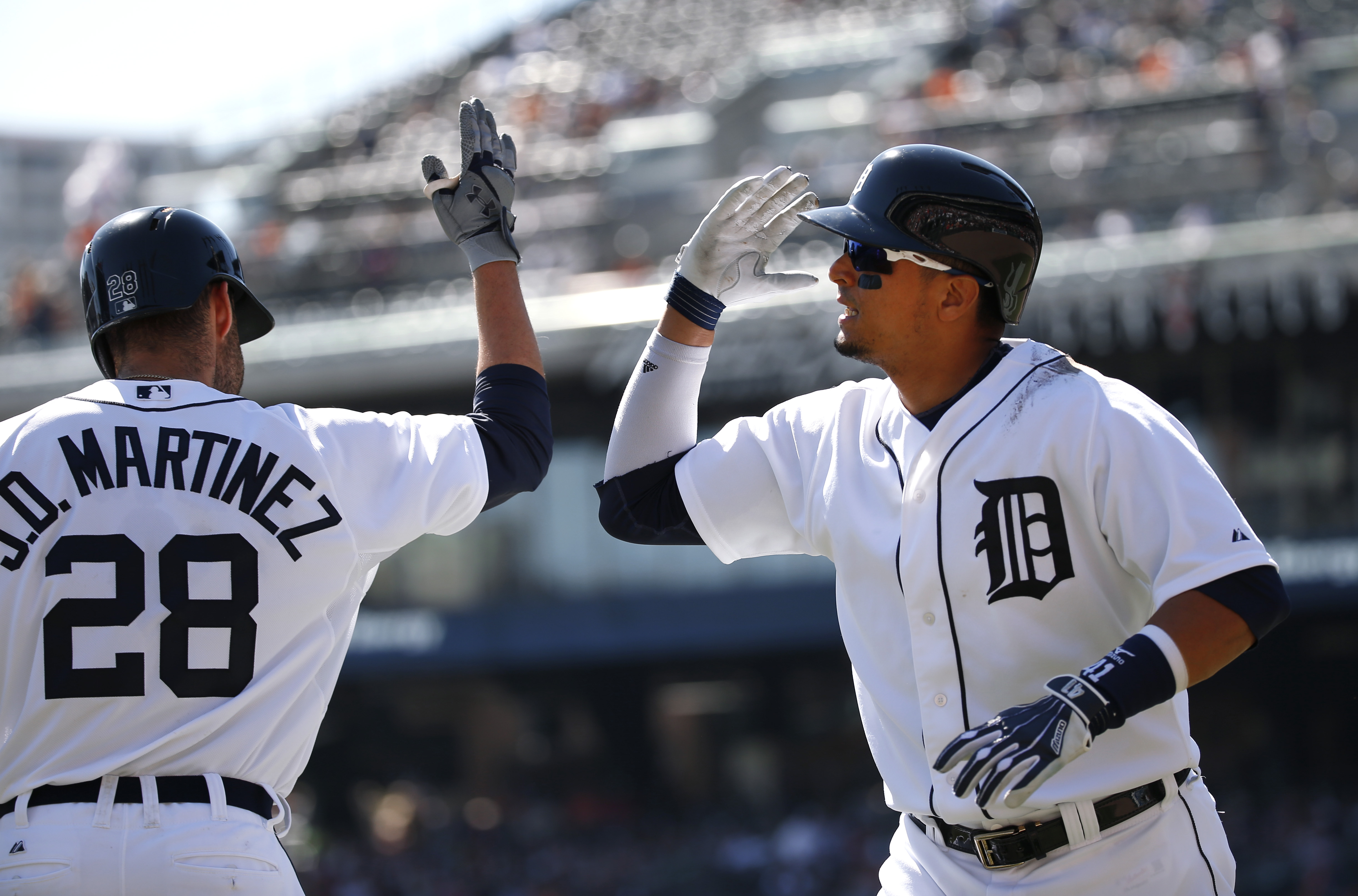 Detroit Tigers' Victor Martinez, right, celebrates his two-run home run of off Chicago White Sox pitcher Frankie Montas with teammate J.D. Martinez (28) in the first inning of a baseball game in Detroit, Wednesday, Sept. 23, 2015. (AP Photo/Paul Sancya)
