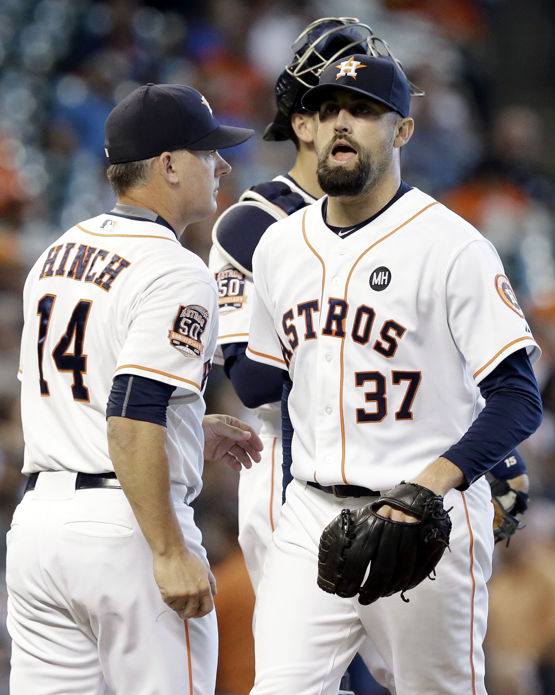Houston Astros relief pitcher Pat Neshek (37) passes manager A.J. Hinch (14) as he leaves the mound after allowing the Los Angeles Angels to score three runs in the eighth inning of a baseball game Wednesday, Sept. 23, 2015, in Houston. (AP Photo/Pat Sull